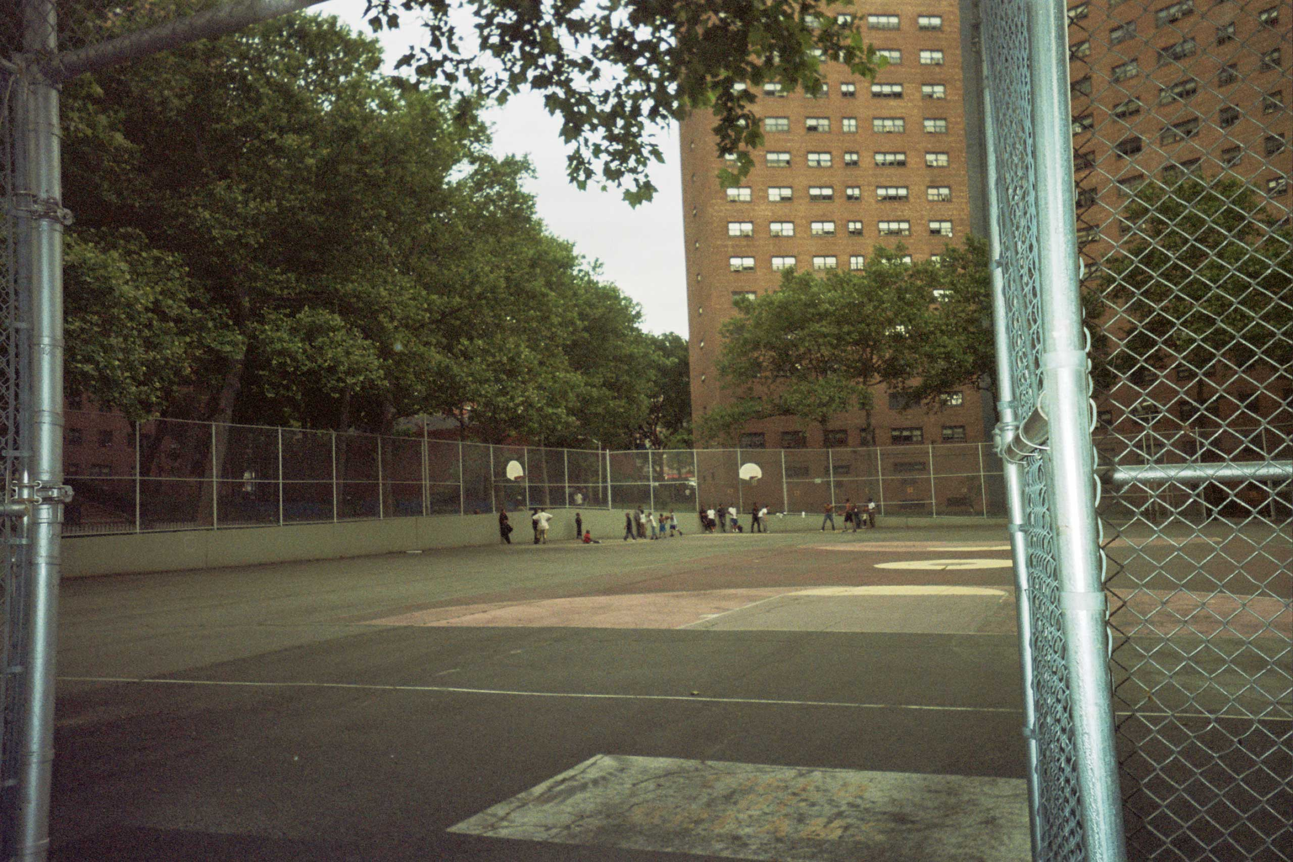 Remember when the ball field was a dust bowl? Now paved, kids love to play basketball.