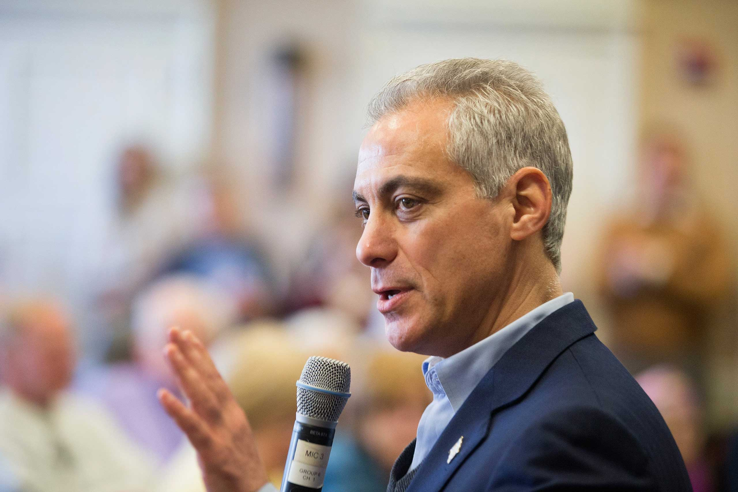 Chicago Mayor Rahm Emanuel talks with residents at a senior living center during a campaign stop on Feb. 23, 2015 in Chicago.