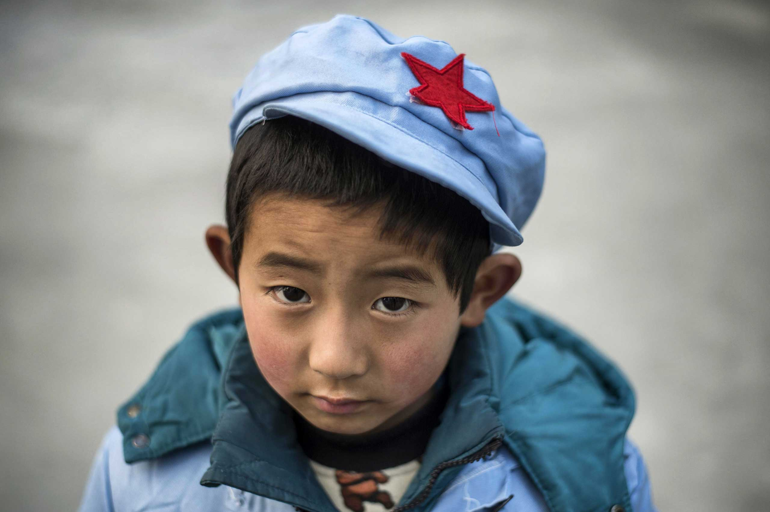 A boy waits at the Beichuan Red army elementary school.