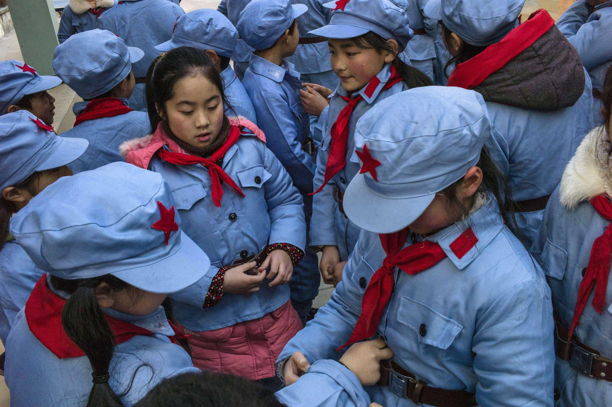 Children wait to enter their classroom.