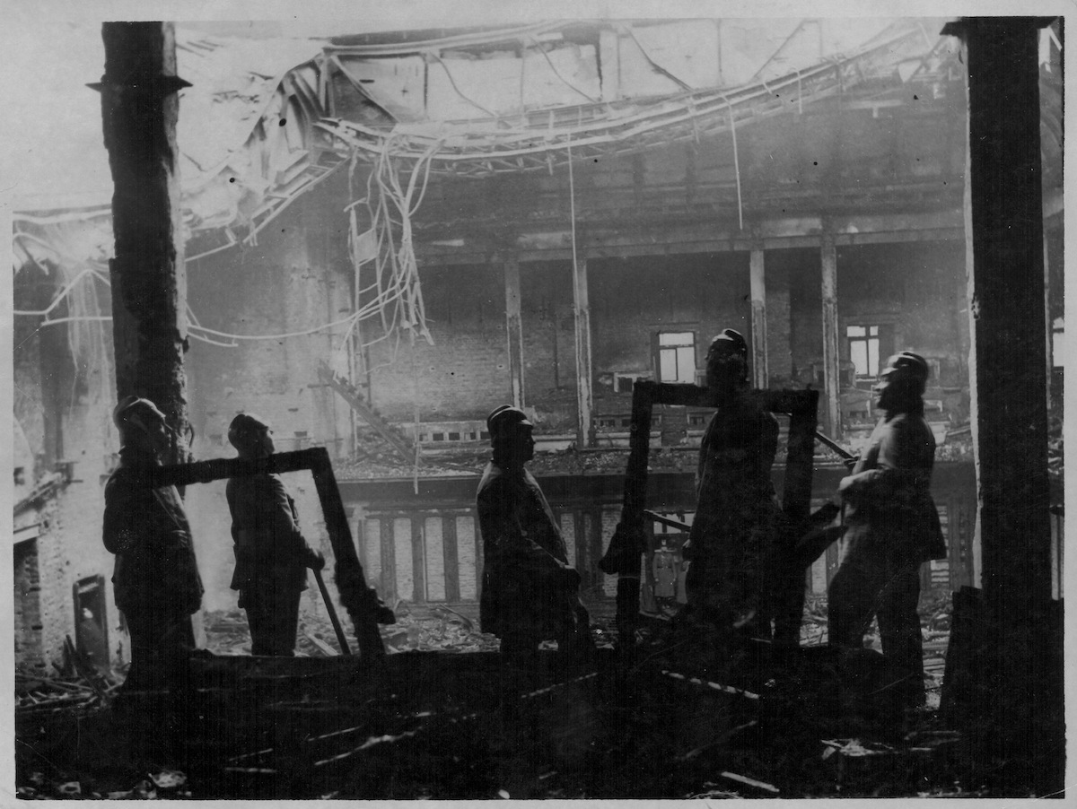 Firemen surveying the ruins following the Reichstag fire in Germany, 1933.