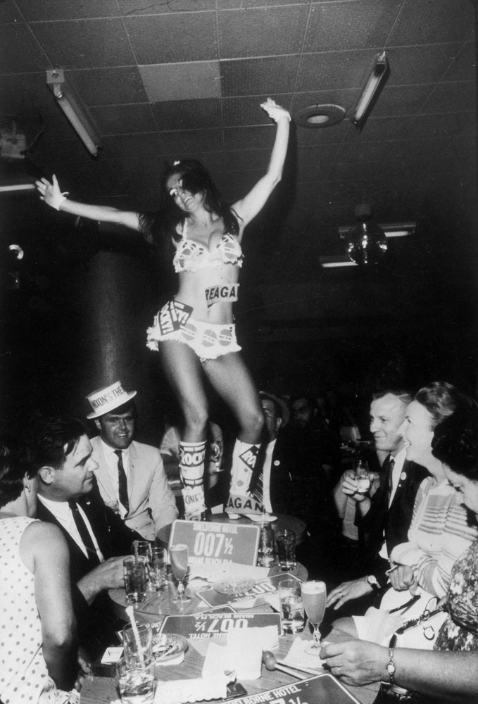 Go-go girl and delegates during the 1968 Republican National Convention, Miami Beach, Florida.