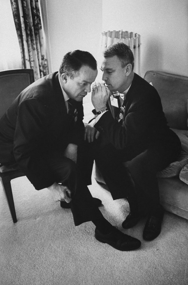 Arizona politician and future U.S. Attorney General Richard Kleindienst (left) confers with Nebraska's Richard Herman during the 1964 GOP National Convention in San Francisco.