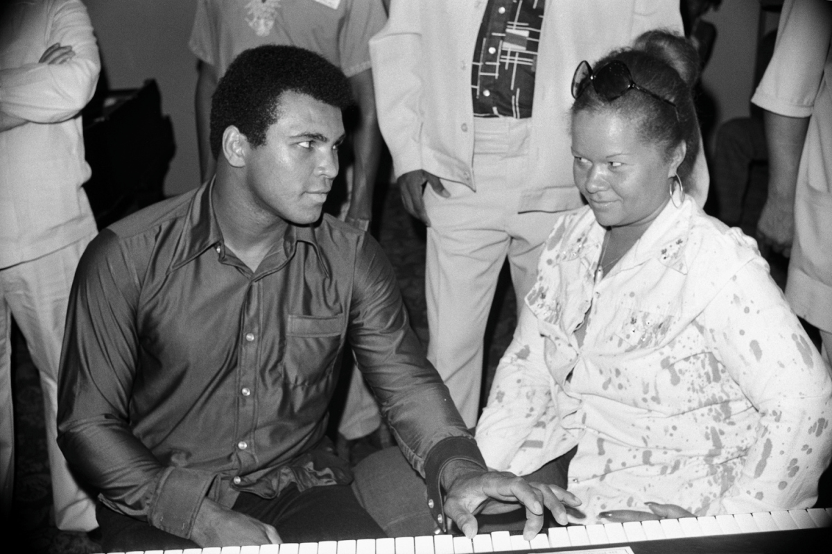 Ali and Etta James in Zaire, 1974                               Lynn Goldsmith:  I made this image of Muhammad Ali and Etta James in Zaire, Africa, in September of 1974. There was a music festival that was going to be on at the same time as the Ali-Foreman  Rumble in the Jungle  fight. It was intended to promote racial and cultural solidarity between African-American and African people. Artists like James Brown, B.B. King, the Spinners, Bill Withers, the Pointer Sisters, etc,. were scheduled to perform. Often after a day of training at his camp, Ali would hang out with some of these musicians. His strong, charismatic personality overwhelmed them. He always took control of the room because he was the Greatest. The only exception was with Etta. Unlike the bravado he had around other artists, Ali seemed like a little boy looking for her approval. He knew just how to get into anyone's heart.  Lynn Goldsmith is a celebrity-portrait photographer.