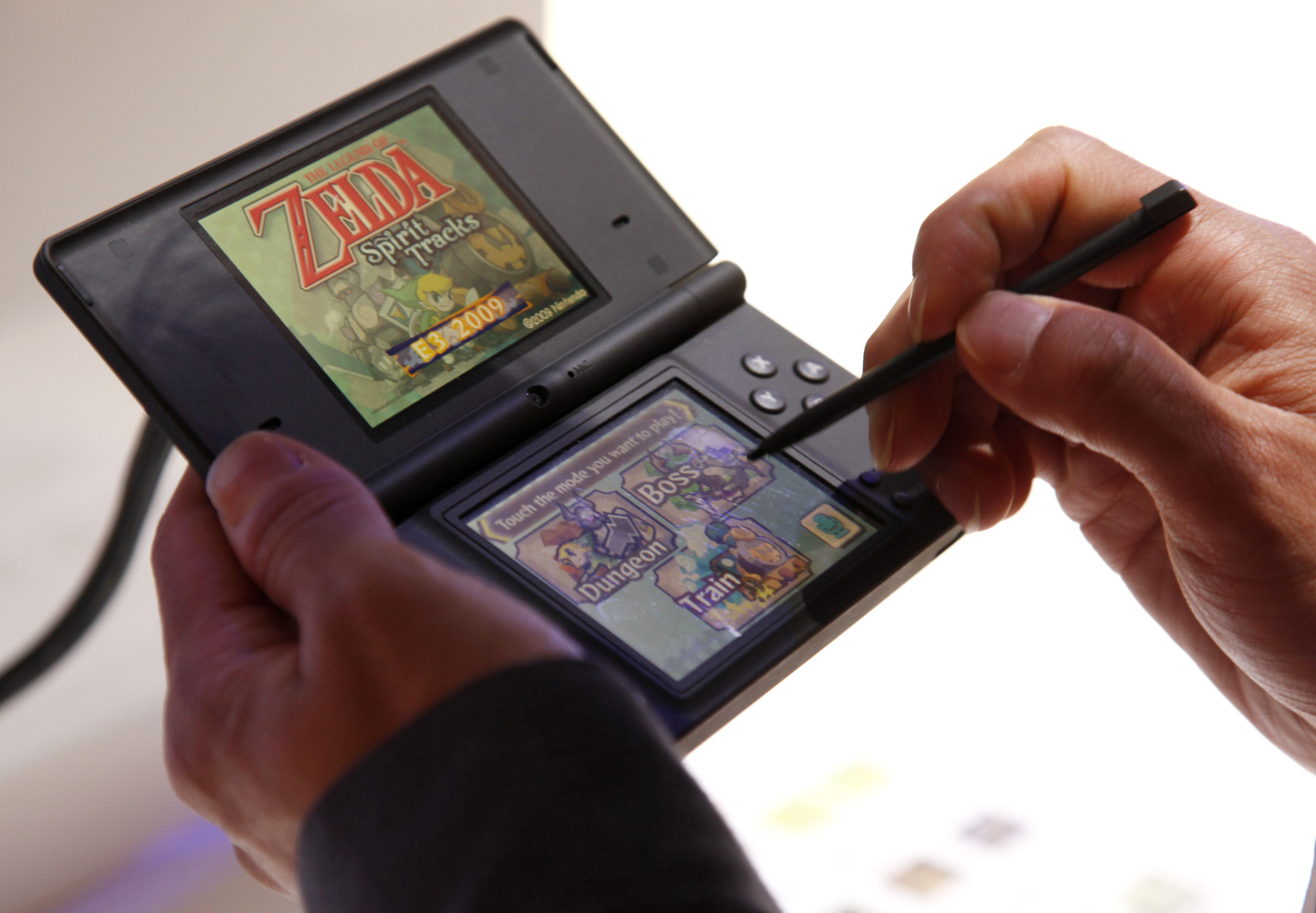 This June 3, 2009 photo shows a visitor playing  The Legend of Zelda: Spirit Tracks  video game on the Nintendo DS during the Electronic Entertainment Expo in Los Angeles.