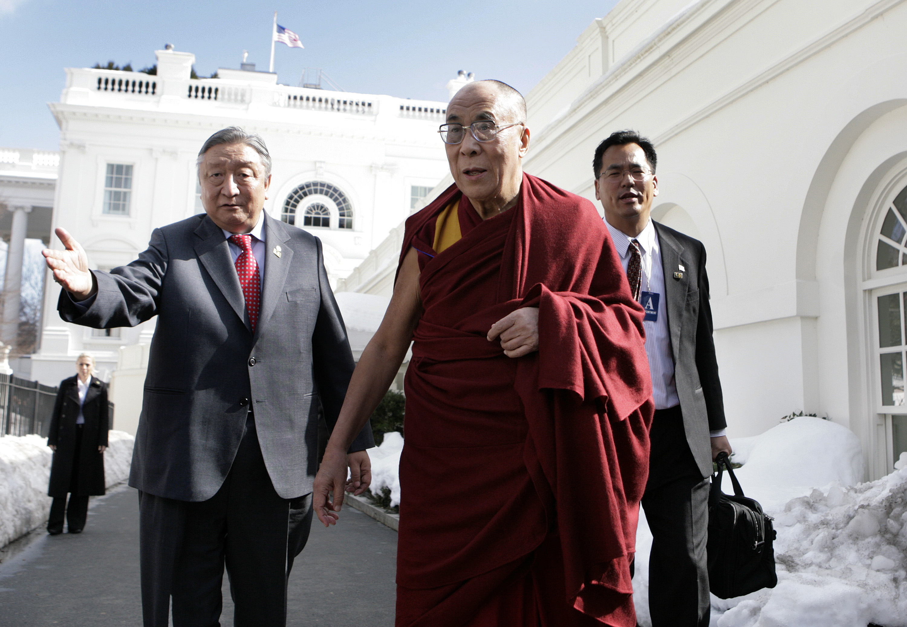 Tibetan spiritual leader the Dalai Lama walks outside the White House after his meeting with U.S. President Barack Obama  in Washington on Feb. 18, 2010