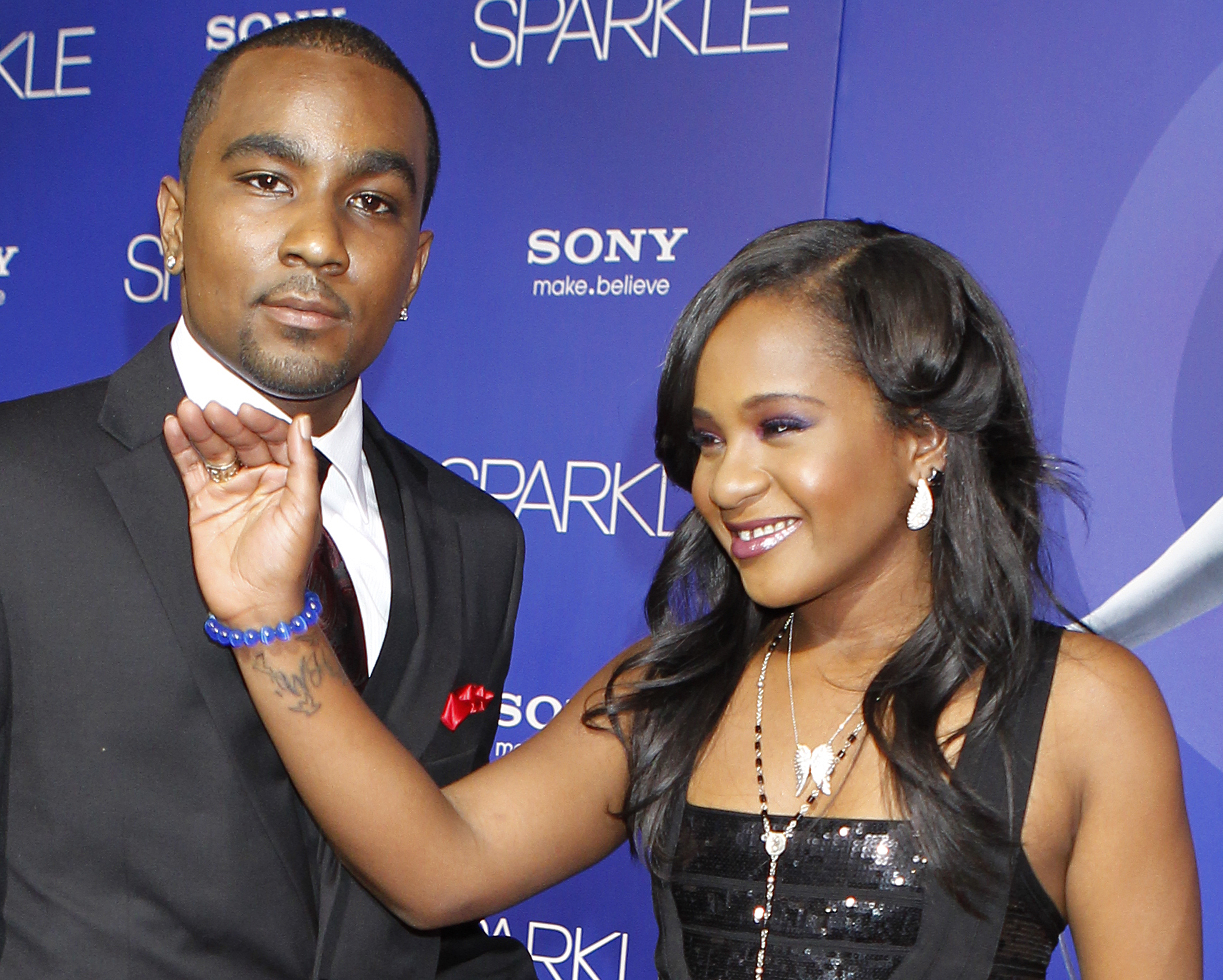 Bobbi Kristina Brown, daughter of the late singer Whitney Houston, arrives with boyfriend Nick Gordon at the premiere of the new film Sparkle in Hollywood on Aug. 16, 2012