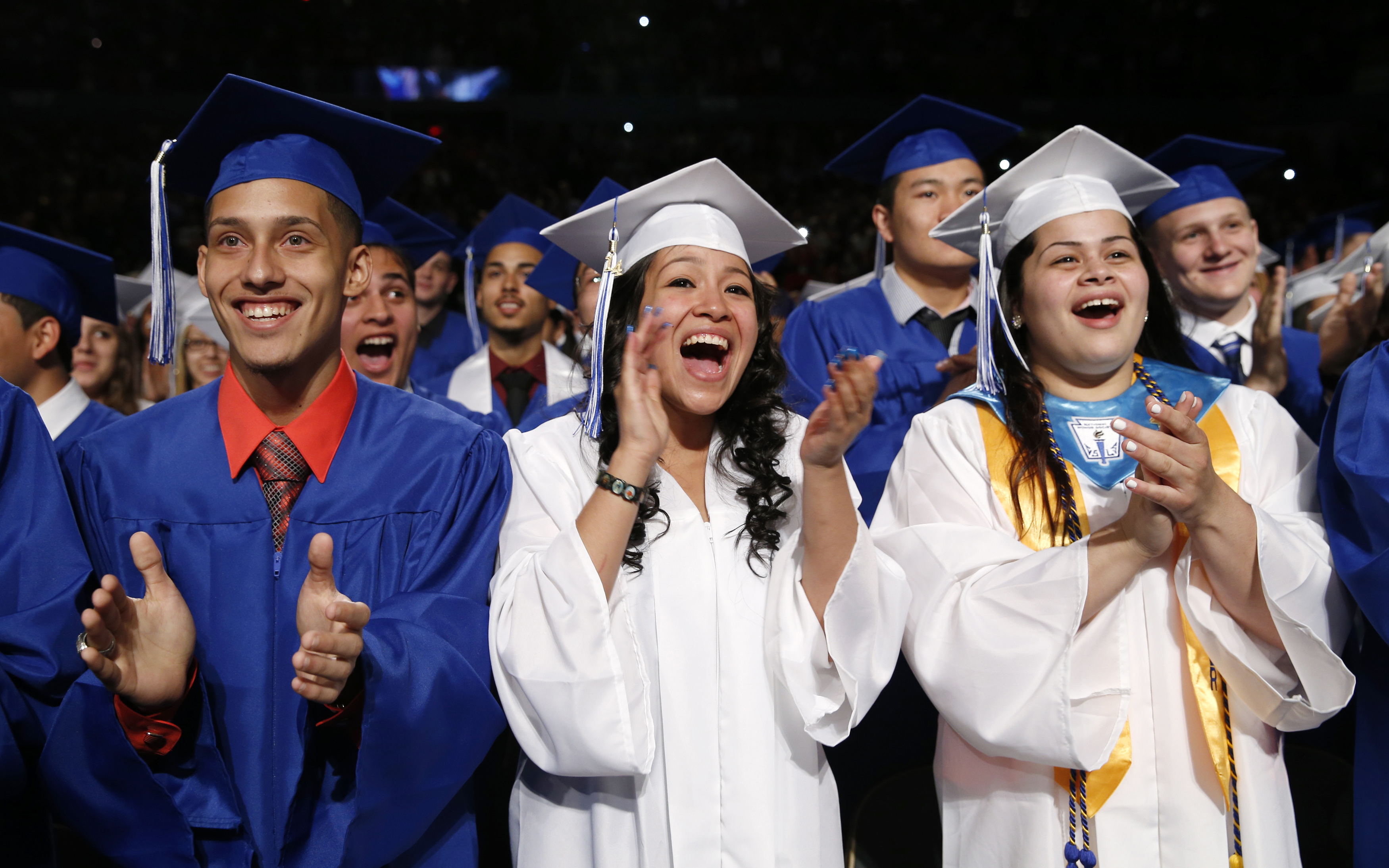 Students applaud as U.S. President Barack Obama arrives to deliver the commencement address at the Worcester Technical High School graduation ceremony in Worcester, Massachusetts June 11, 2014
