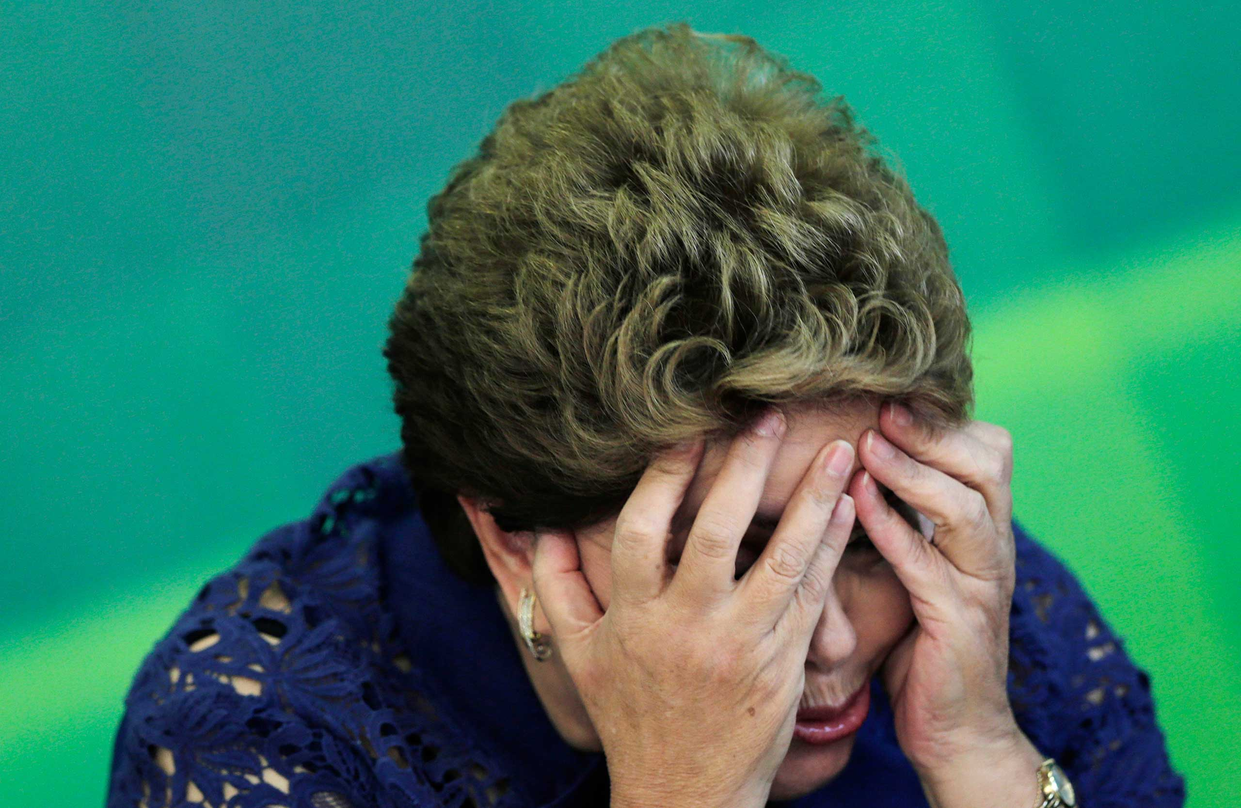 Brazilian President Dilma Rousseff reacts during a breakfast meeting with the media at the Planalto Palace in Brasilia, Dec. 22, 2014.