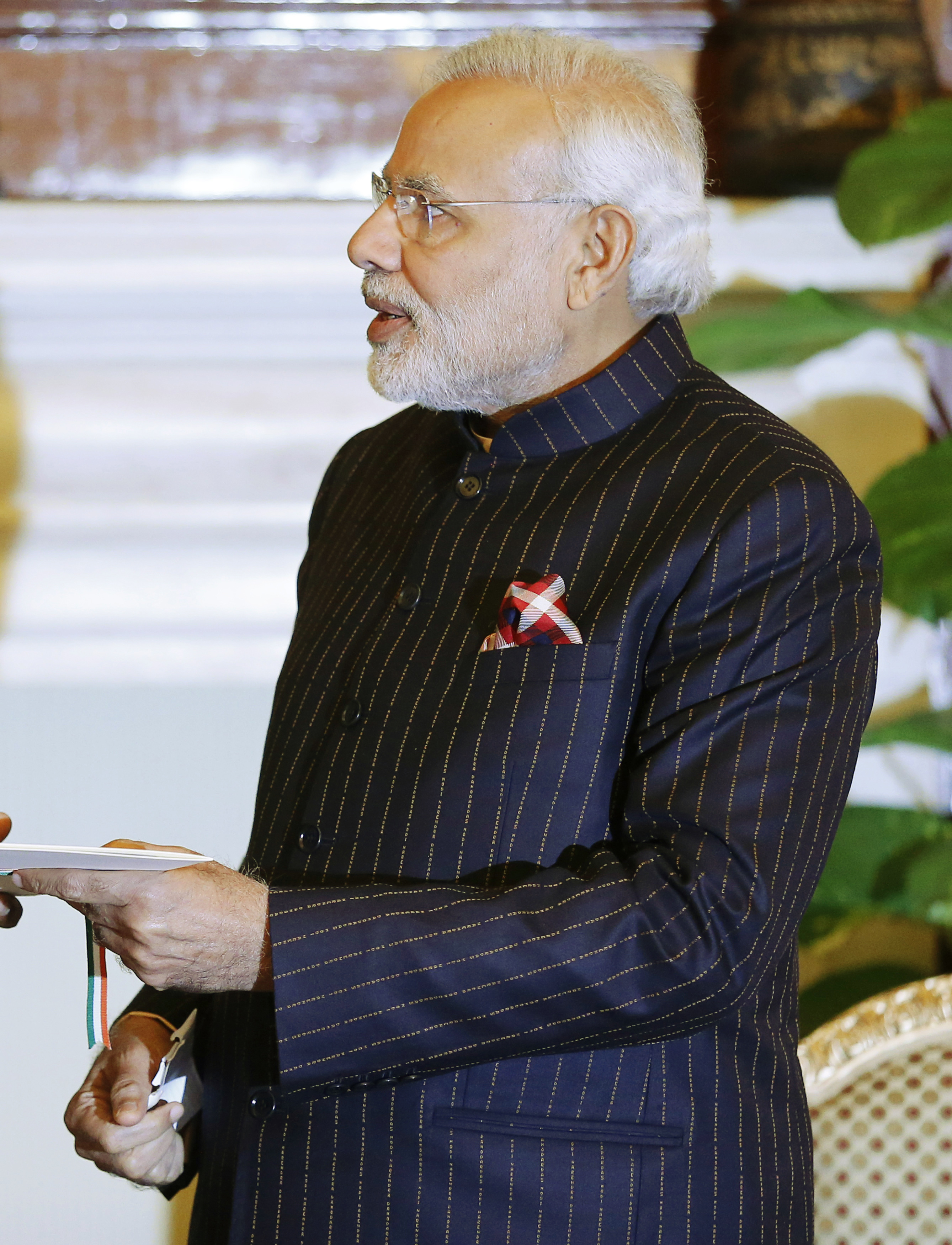 Indian Prime Minister Narenda Modi, wearing a dark pinstripe suit embroidered with his name, meets with U.S. President Barack Obama at Hyderabad House in New Delhi on Jan. 25, 2015