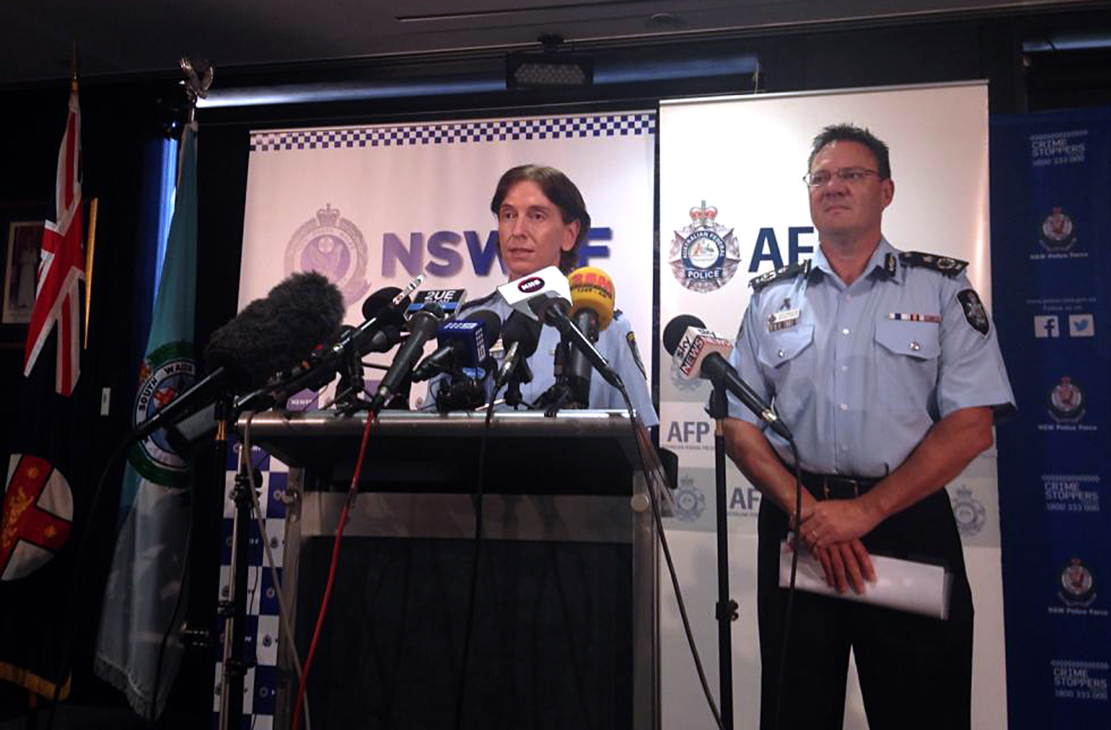 Australian Federal Police Deputy Commissioner Michael Phelan, right, listens as New South Wales Deputy Police Commissioner Catherine Burn speaks during a media conference in Sydney on Feb. 11, 2015