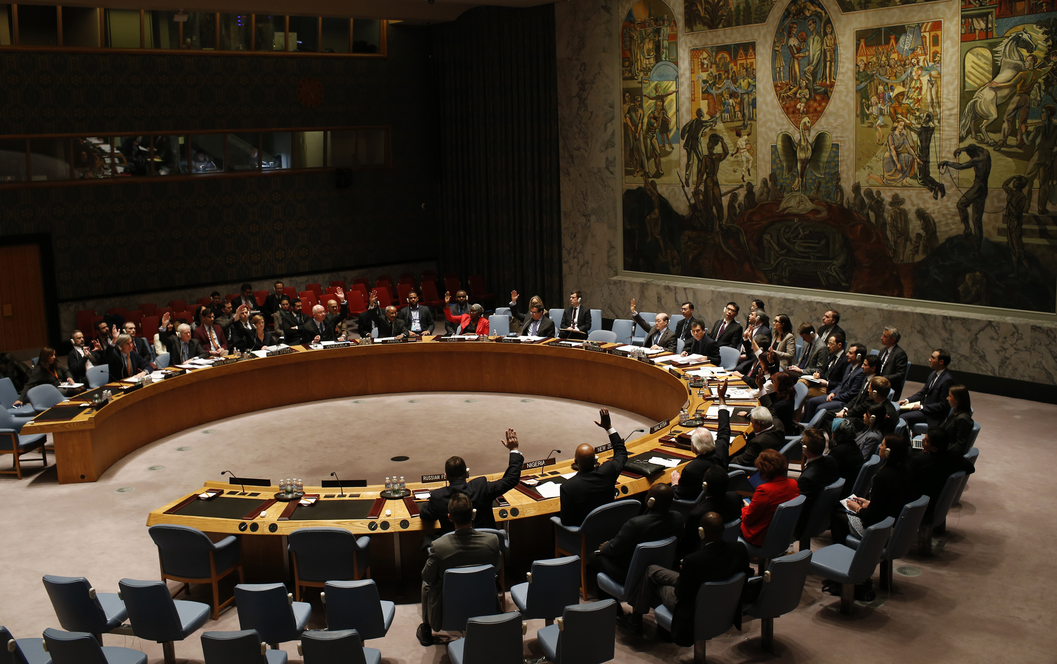The U.N. Security Council votes in favor of a resolution demanding the Houthi militia's withdrawal from Yemeni government institutions during a meeting at the U.N. headquarters in New York City on Feb. 15, 2015