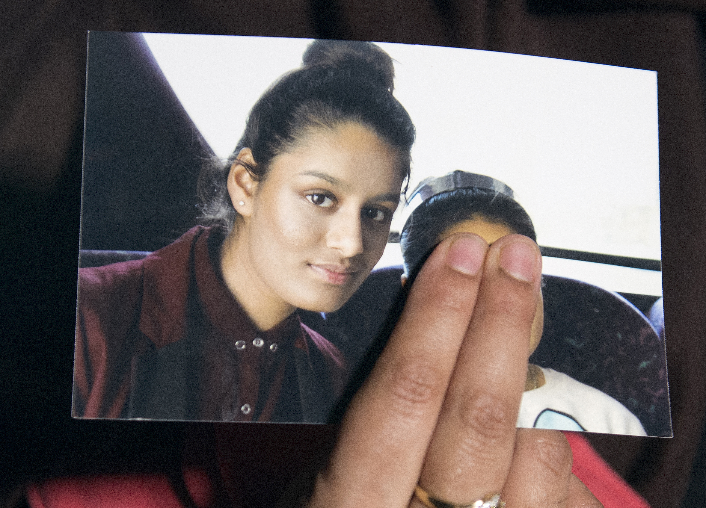 Renu Begun, sister of teenage British girl Shamima Begun, holds a photo of her sister as she makes an appeal for her to return home at Scotland Yard in London on Feb. 22, 2015