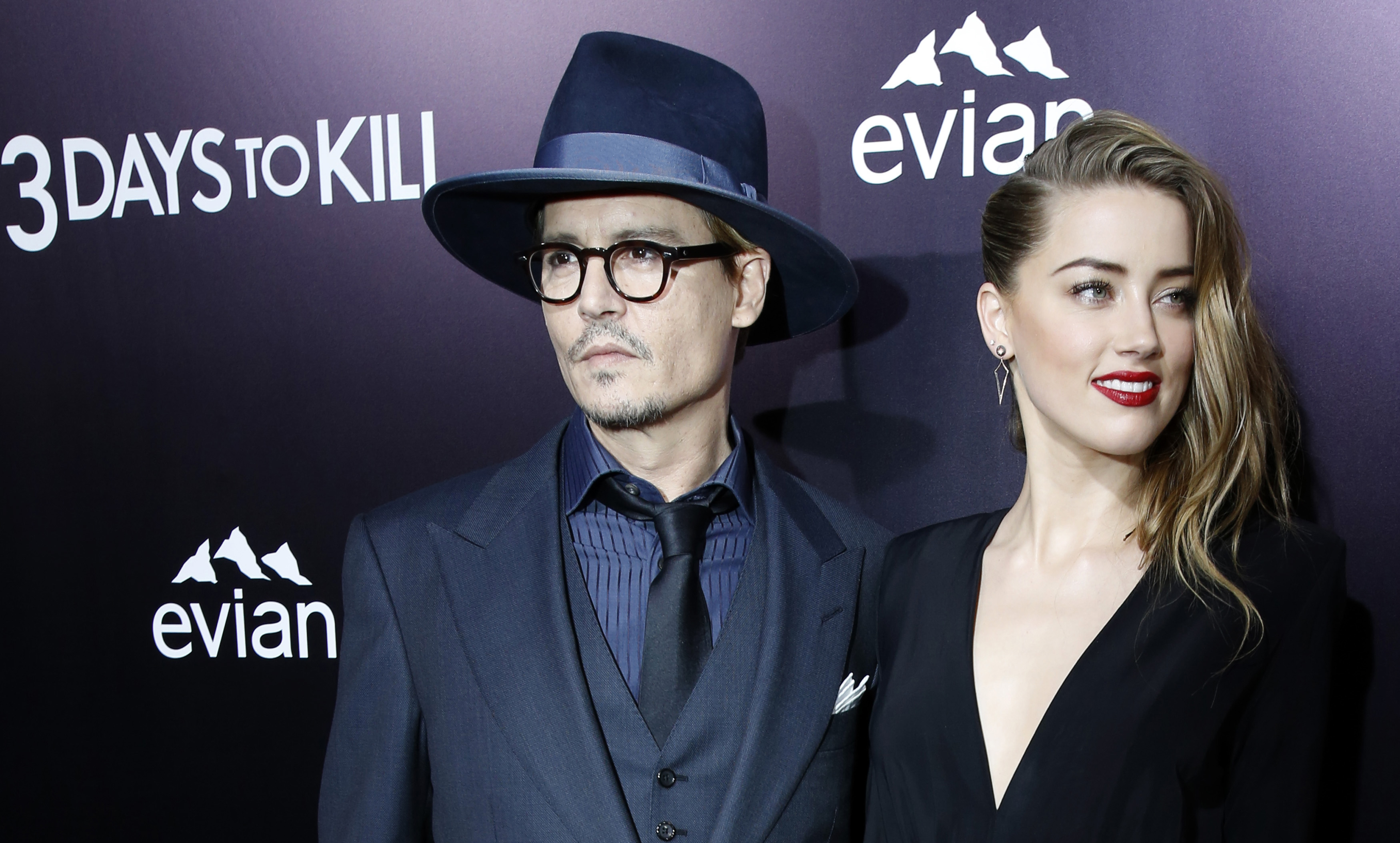 Actress Amber Heard and actor Johnny Depp at the premiere of 3 Days to Kill in Los Angeles on Feb. 12, 2014