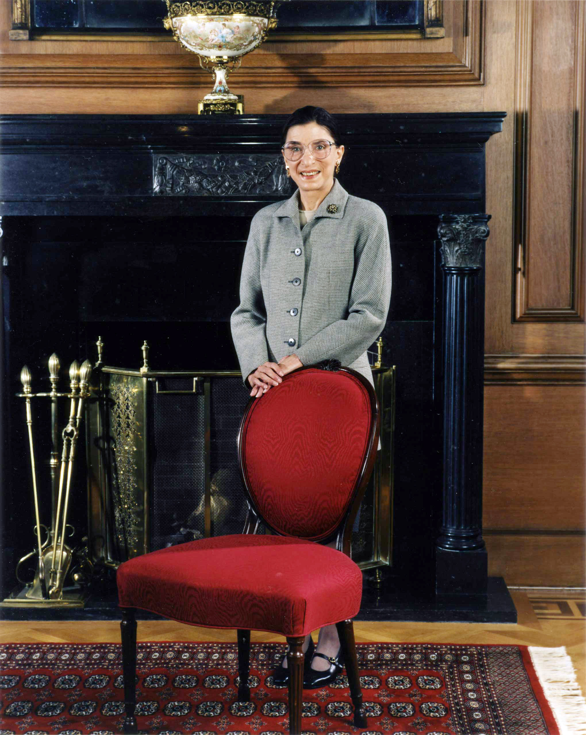 <b>Oct. 1, 1993</b> Informal portrait of Justice Ruth Bader Ginsburg standing before the mantle in the Justices' Dining Room in Washington.