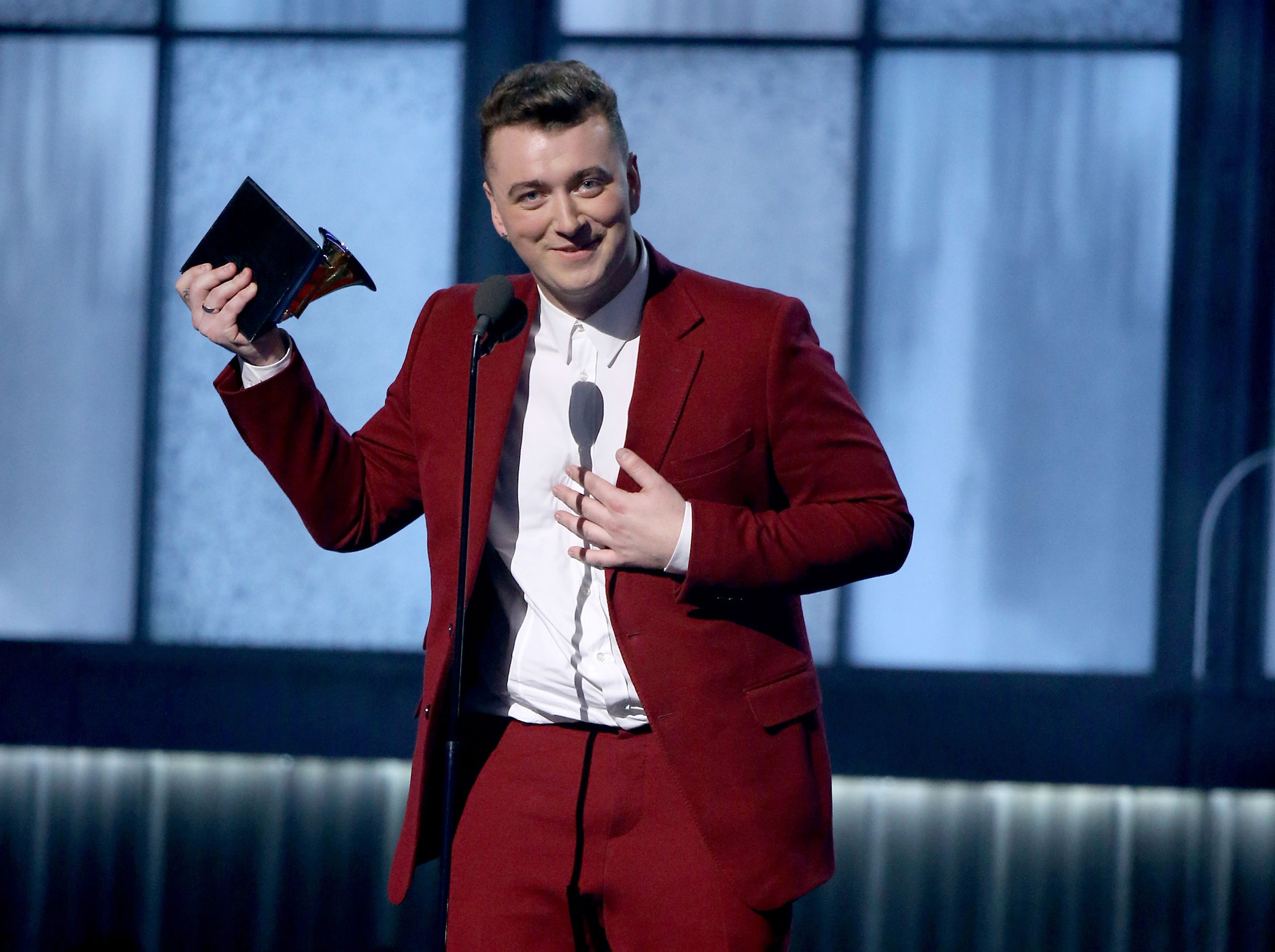 Sam Smith accepts a Grammy onstage at the 57th Annual Grammy Awards in Los Angeles, Feb. 8, 2015.