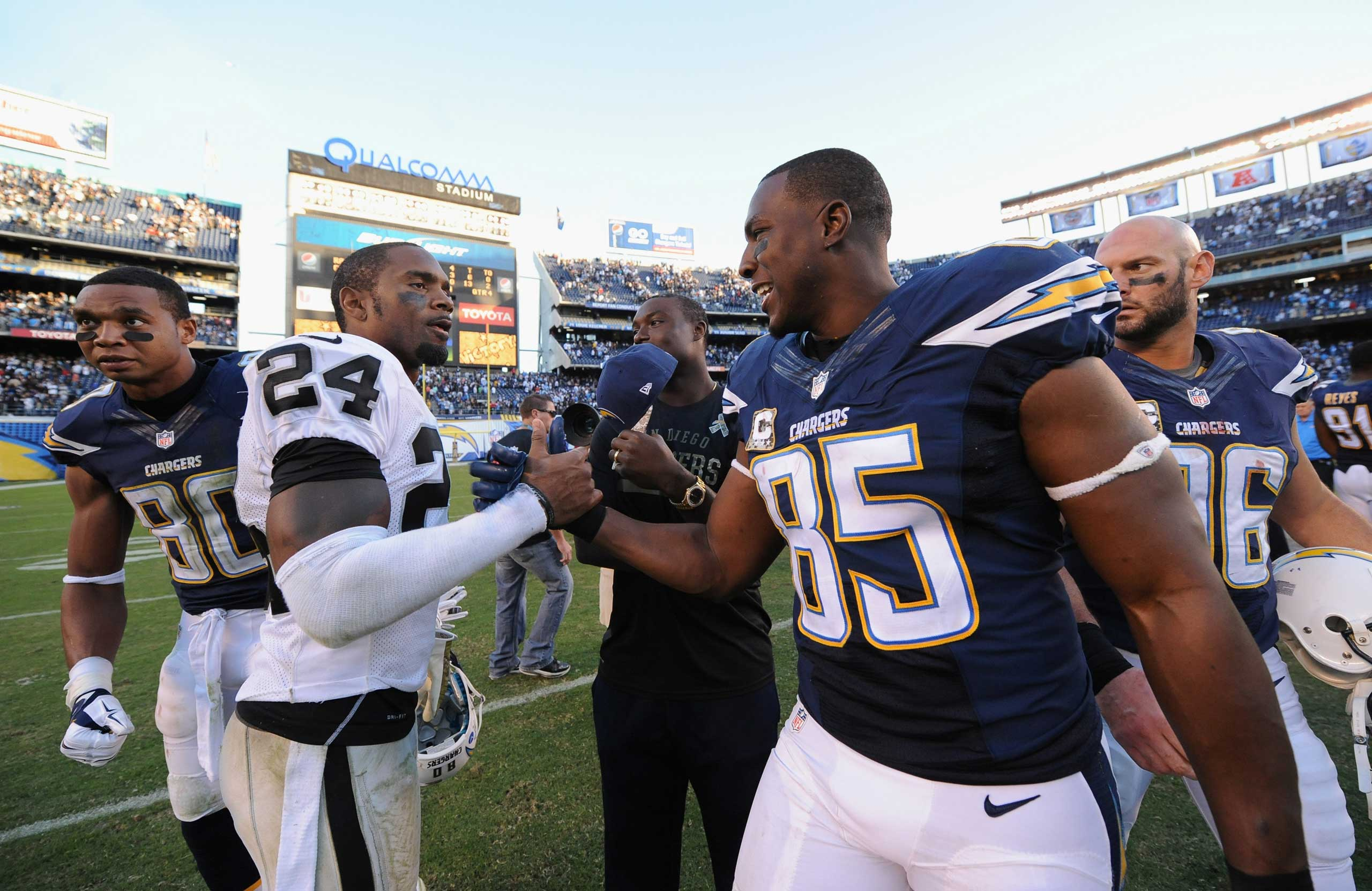 Charles Woodson #24 of the Oakland Raiders congratulated  Antonio Gates #85 of the San Diego Chargers after the Chargers defeated the Oakland Raiders 13-6 in the game at Qualcomm Stadium on Nov. 16, 2014 in San Diego, Calif.