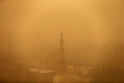 A mosque is seen through the haze of a sandstorm in Cairo, Feb. 11, 2015.