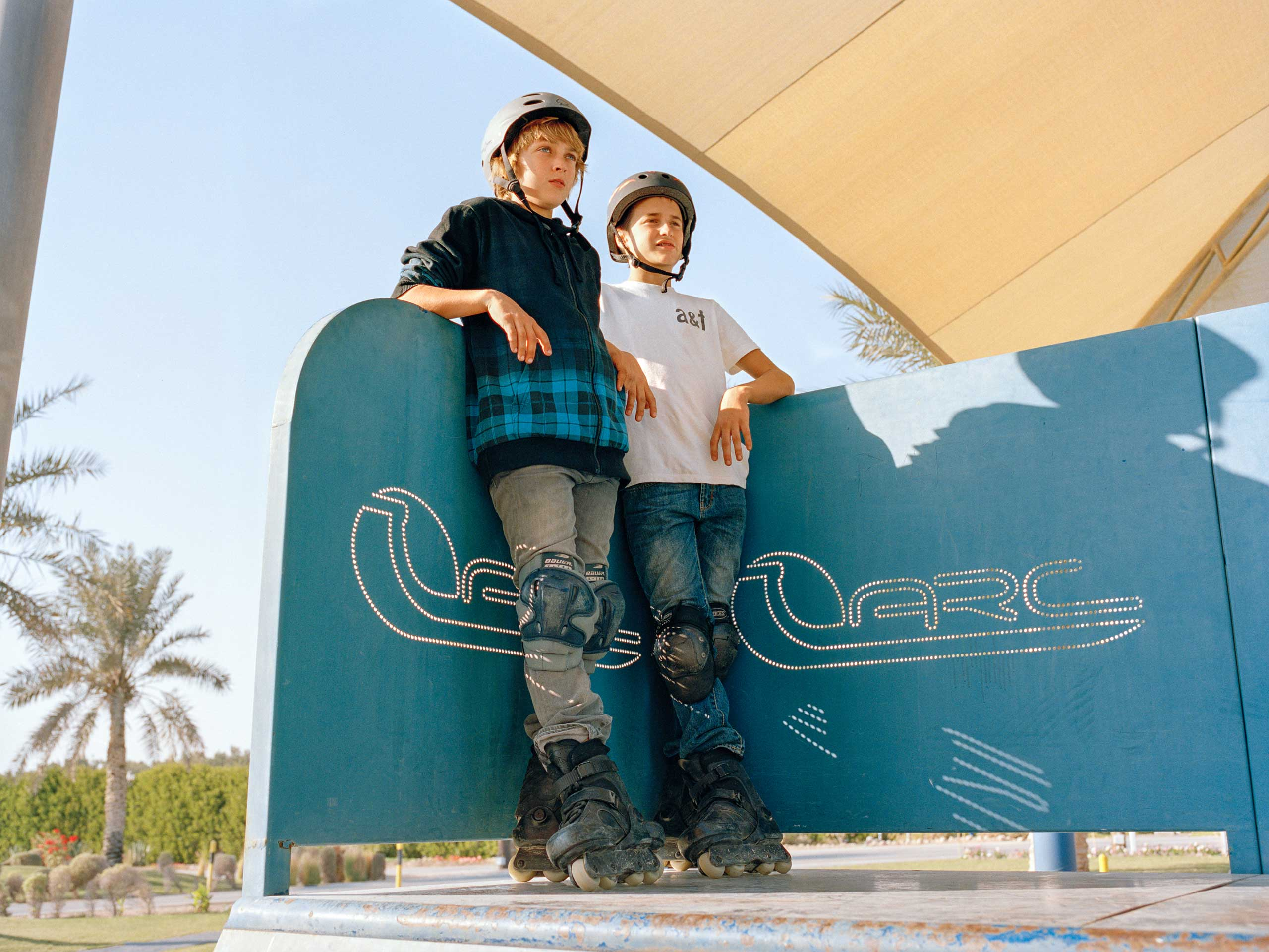 Two boys wait for their turn at a skate competition at the local skate park in Dhahran Hills.