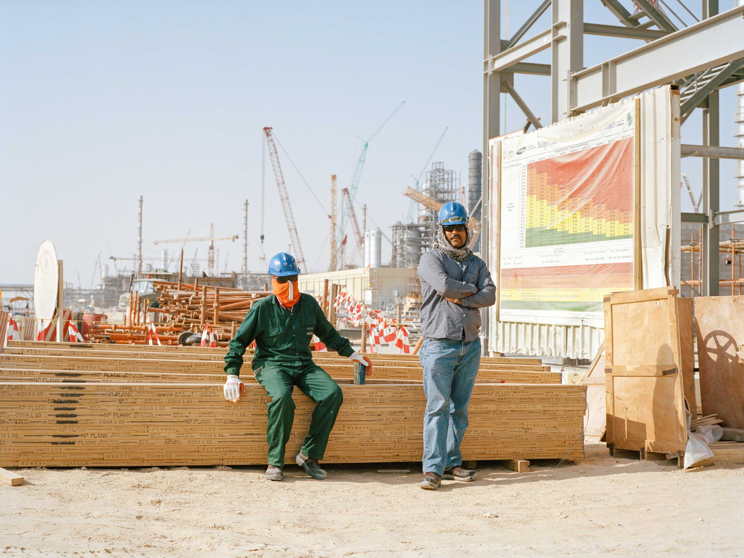 Workers at an oil facility construction site in Jubail.