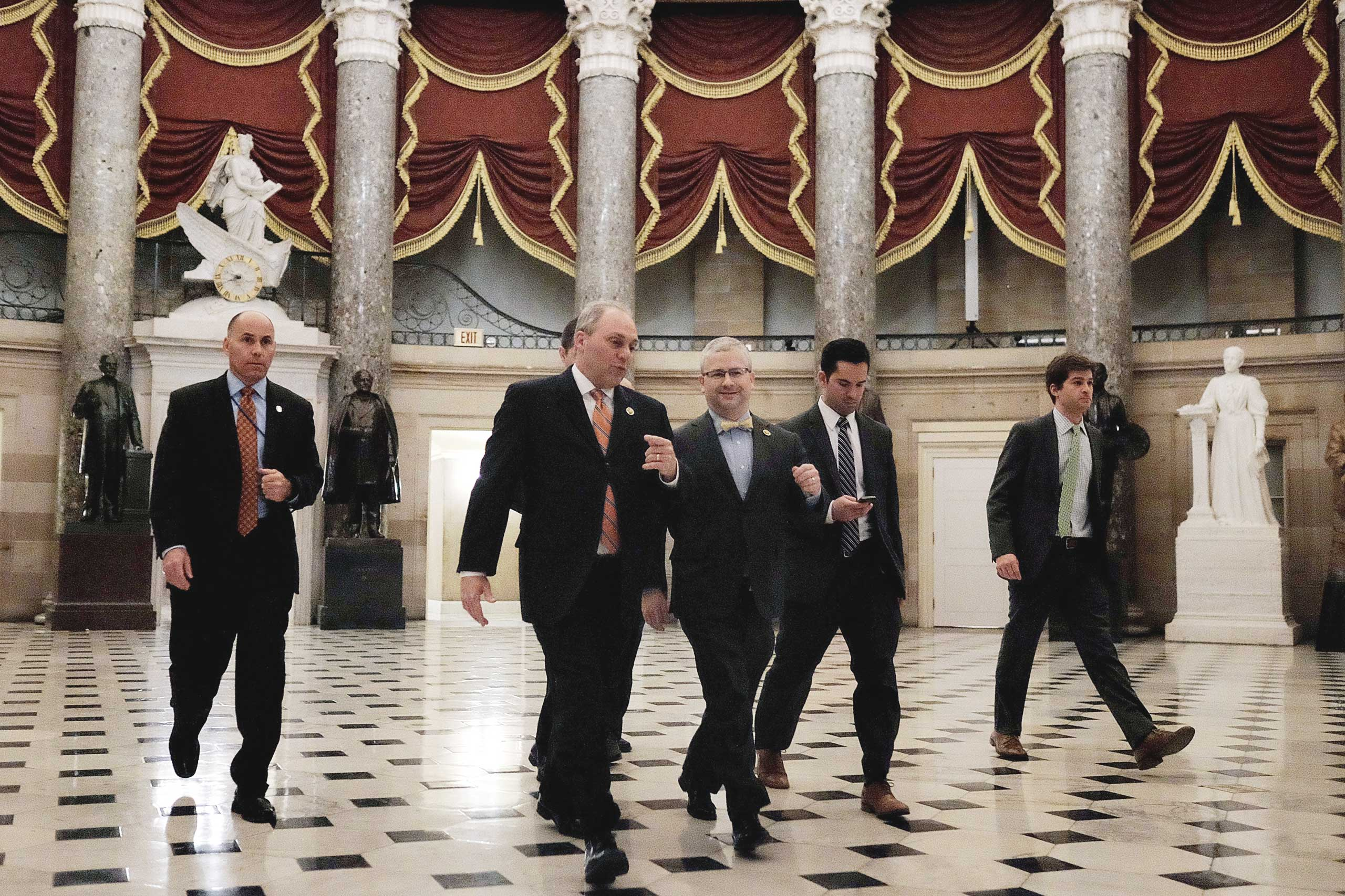 House Majority Whip Rep. Steve Scalise (R-LA), second from left, walks with Deputy Whip Rep. Patrick McHenry (R-NC), at center, on their way to the House chamber to vote on a stopgap spending bill to fund the Department of Homeland Security at the U.S. Capitol on Feb. 27, 2015 in Washington, DC.