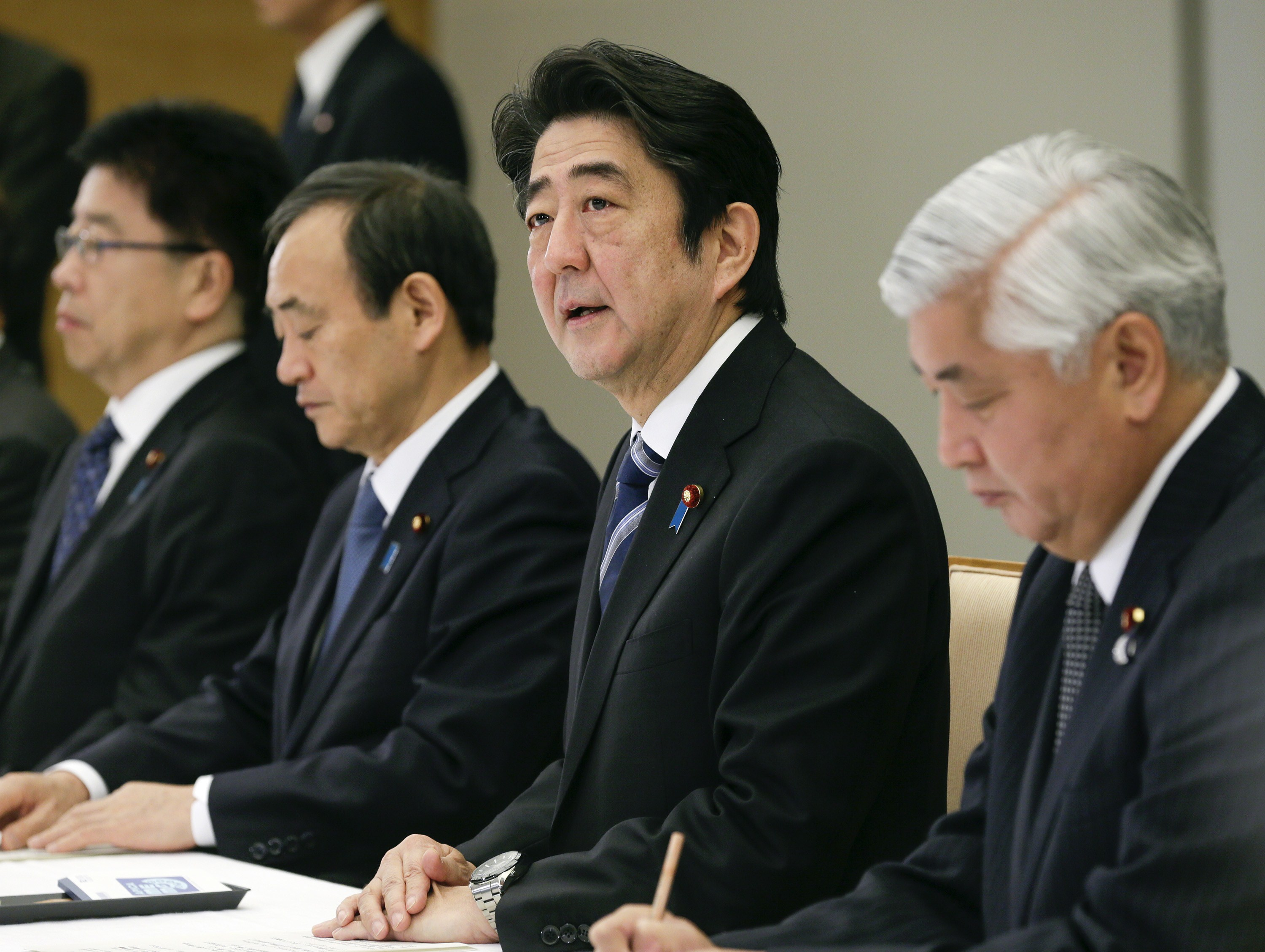 Japanese Prime Minister Shinzo Abe talks during a ministerial meeting on an online video purportedly showing a Japanese hostage being killed by the Islamic State at the prime minister's official residence in Tokyo on Feb. 1, 2015.