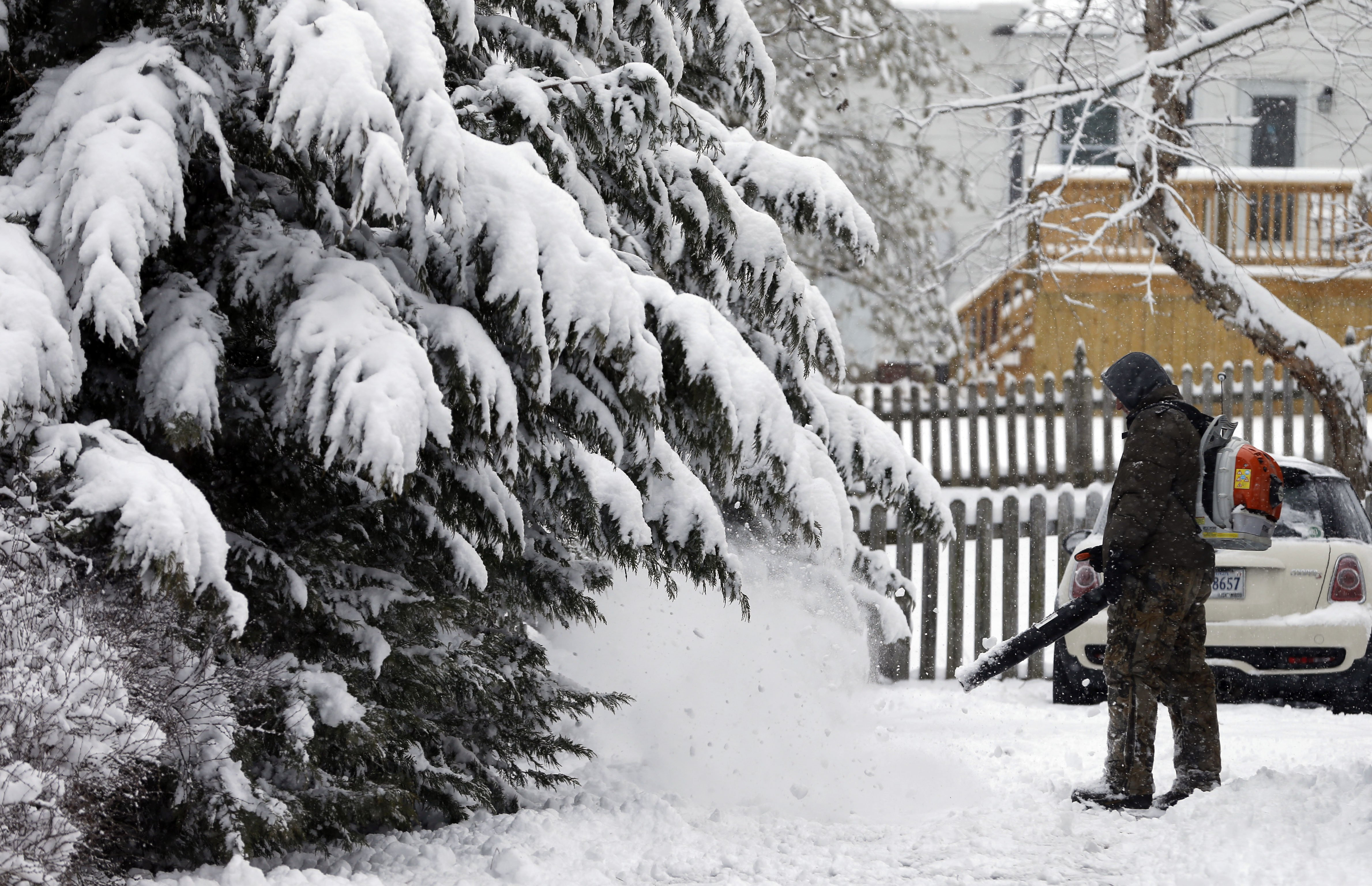 Breck Gorman clears his driveway with a blower during a snowstorm in Richmond, Va. on Feb. 26, 2015.
