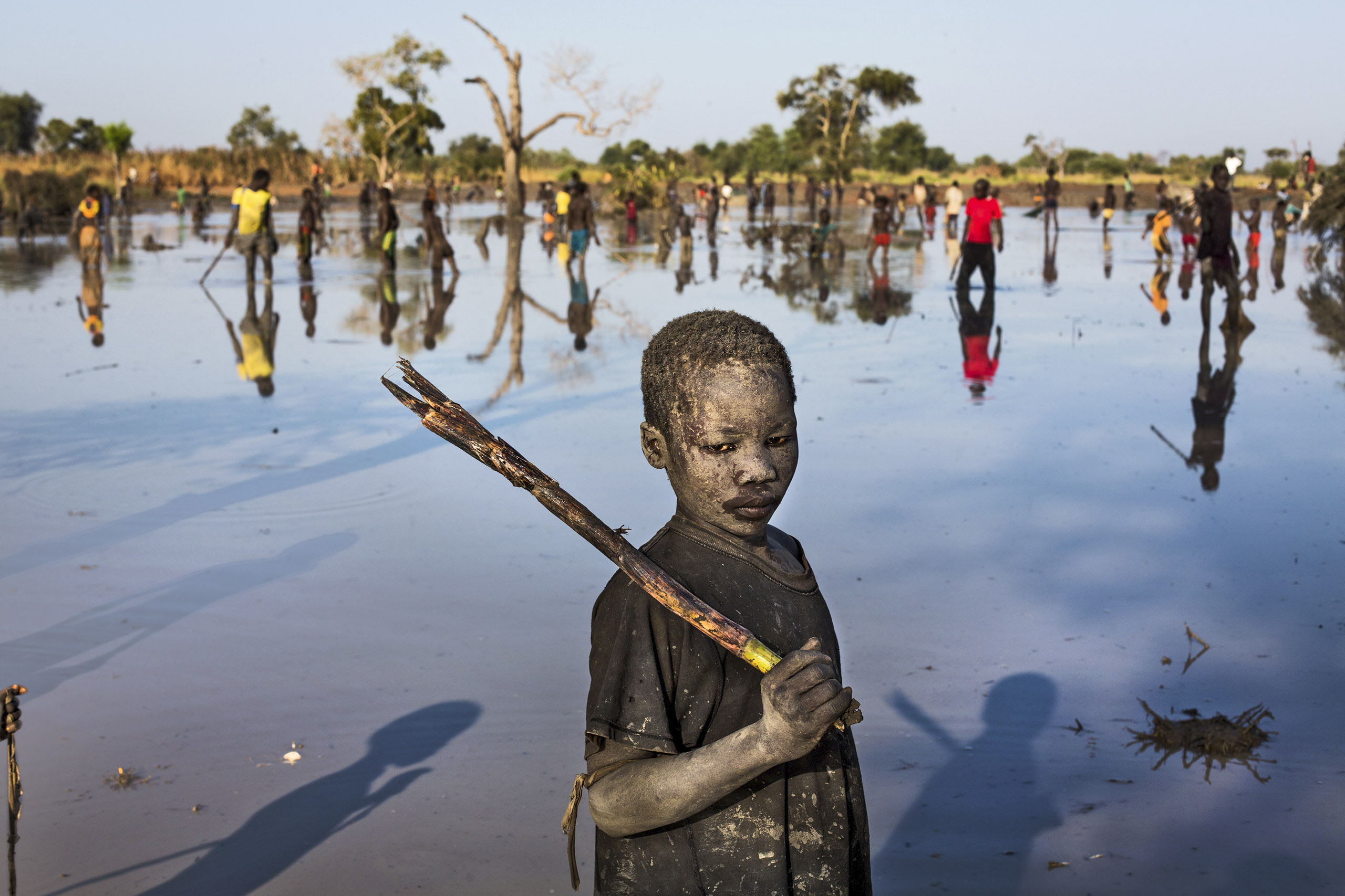 A refugee from Sudan's NubaMountains fishes in South Sudan