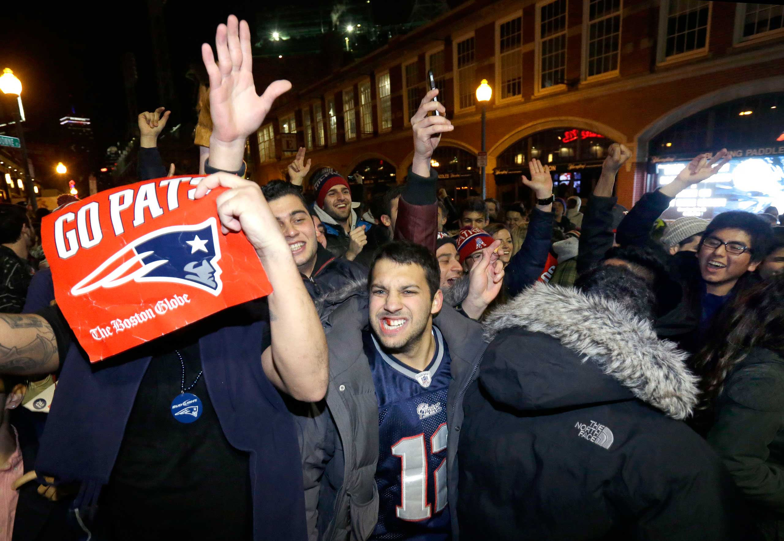 New England Patriots fans celebrate on Feb. 1, 2015 in Boston after the Patriots won the NFL Super Bowl XLIX football game against the Seattle Seahawks 28-24 in Glendale, Ariz.