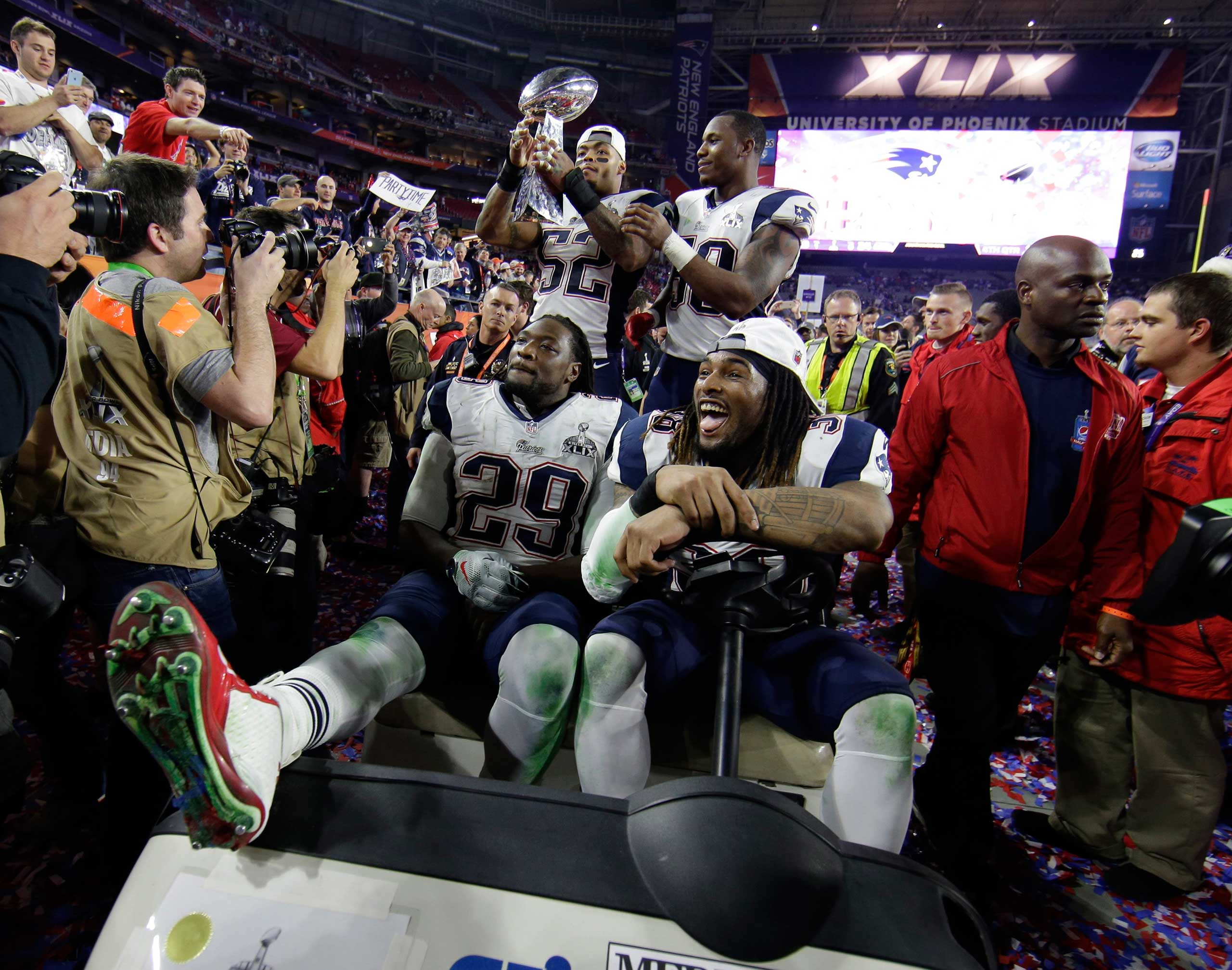 New England Patriots' Jonathan Casillas holds up the Vince Lombardi Trophy as he celebrates with his teammates after the NFL Super Bowl XLIX football game against the Seattle Seahawks on Feb. 1, 2015, in Glendale, Ariz.