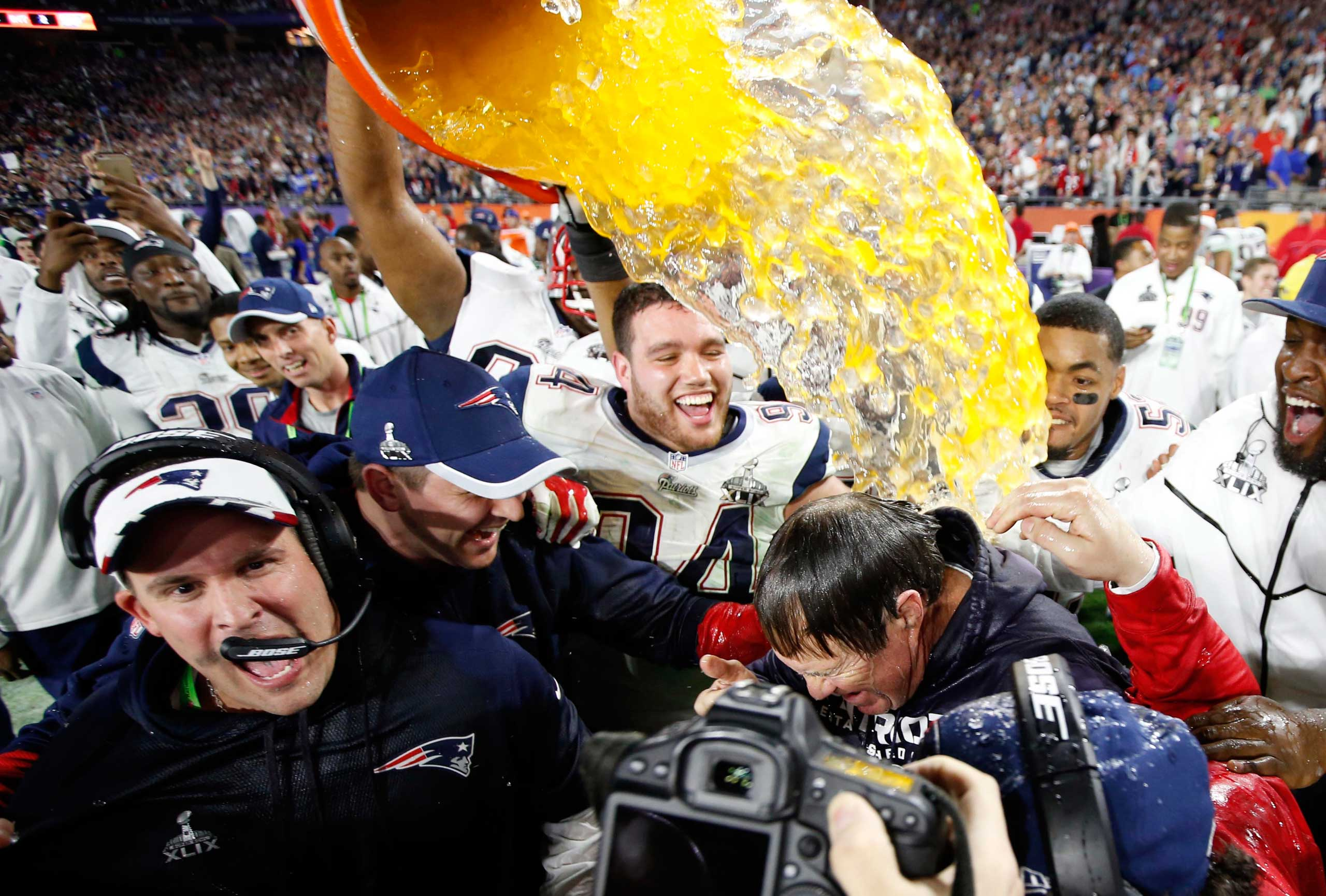 New England Patriots head coach Bill Belichick is dunked with Gatorade after defeating the Seattle Seahawks in Super Bowl XLIX in Glendale, Ariz. on Feb. 1, 2015.