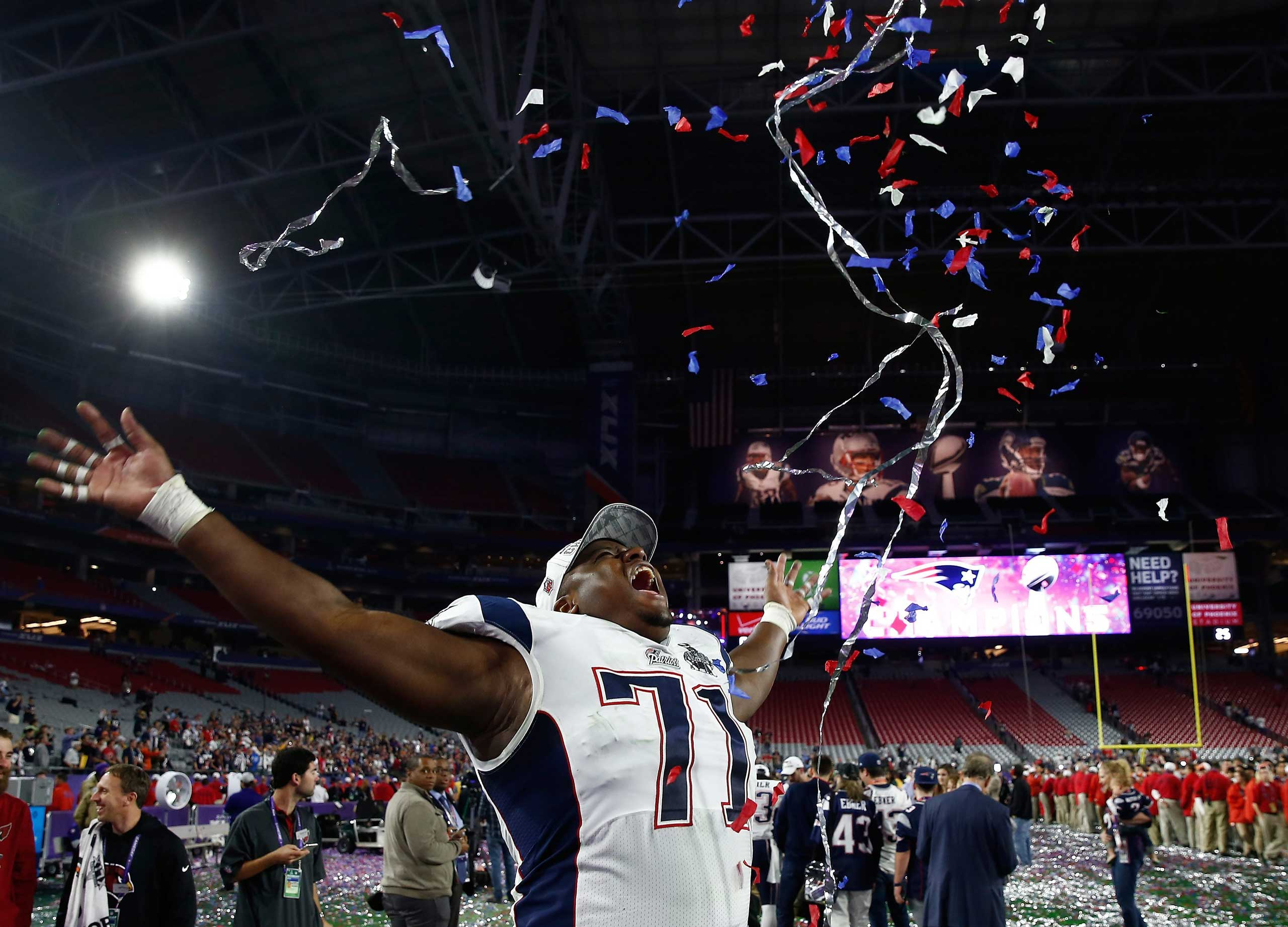 Cameron Fleming of the New England Patriots throws confetti in the air after the New England Patriots defeated the Seattle Seahawks to win Super Bowl XLIX in Glendale, Ariz. on Feb. 1, 2015.