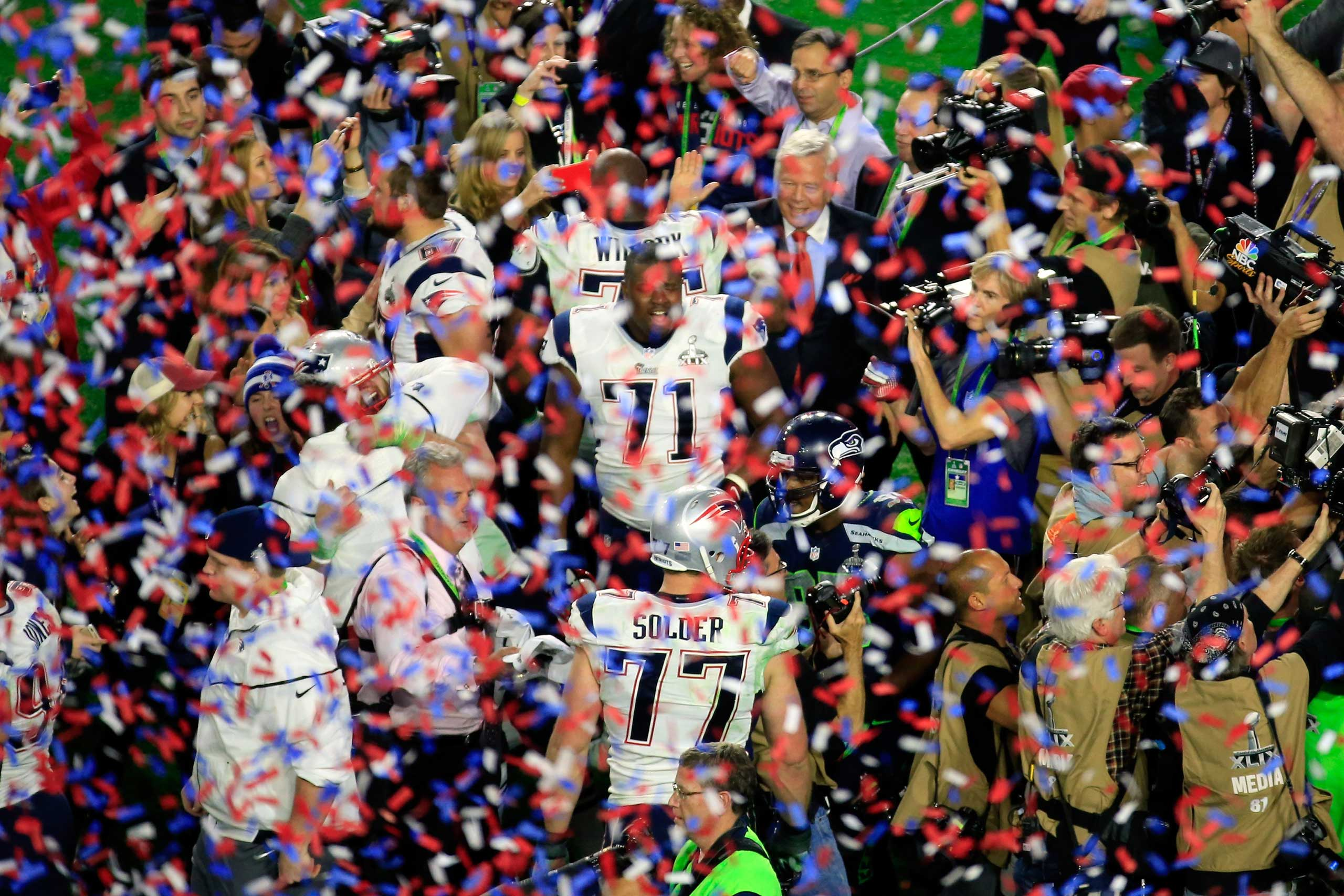 Cameron Fleming of the New England Patriots celebrates with teammates after defeating the Seattle Seahawks during Super Bowl XLIX on Feb. 1, 2015 in Glendale, Ariz.
