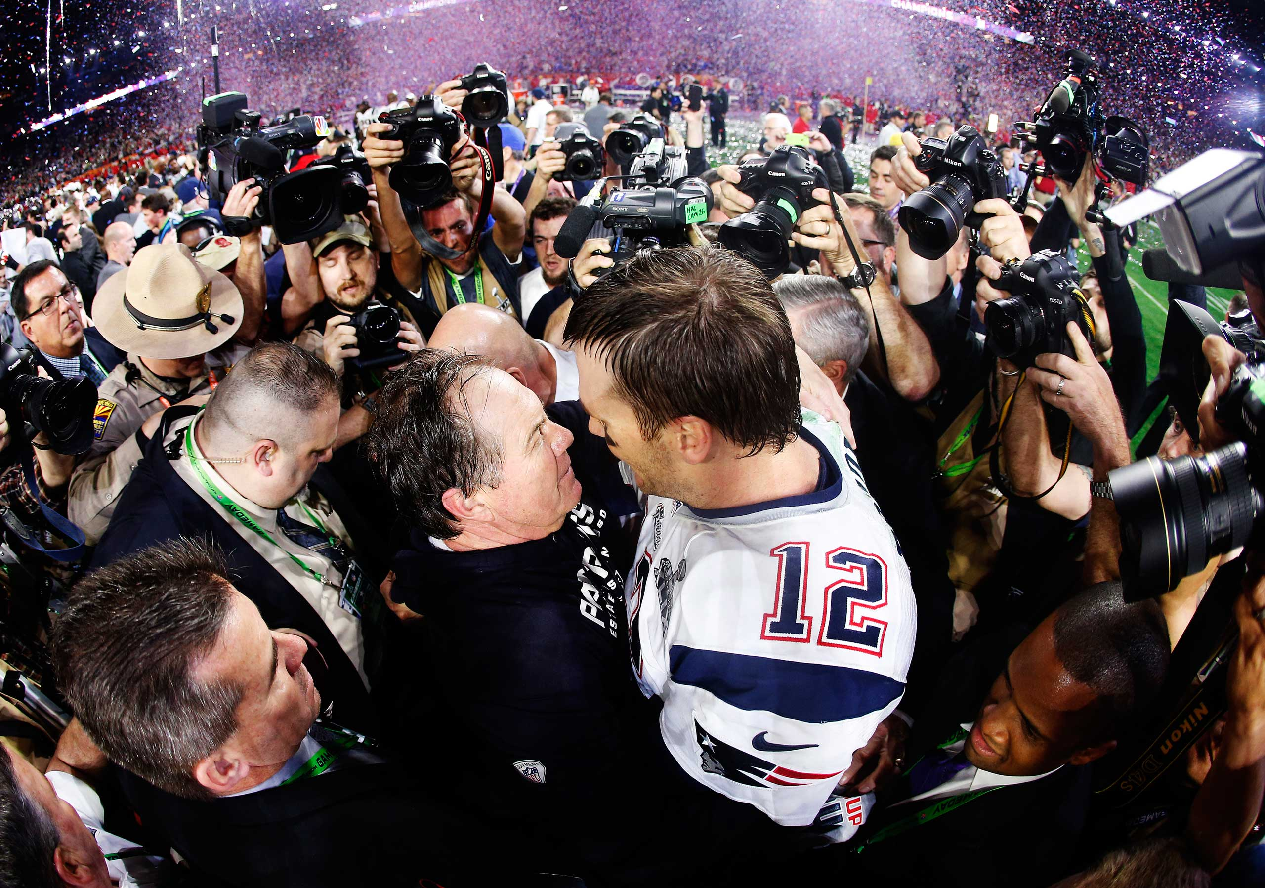 Tom Brady of the New England Patriots celebrates with head coach Bill Belichick after defeating the Seattle Seahawks 28-24 during Super Bowl XLIX on Feb. 1, 2015 in Glendale, Ariz.