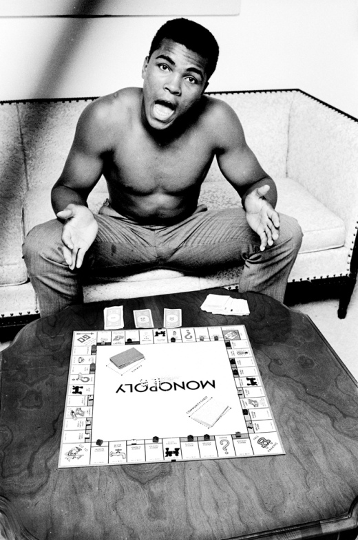 Ali playing Monopoly at home in Louisville, Ky., 1963                               Steve Schapiro:  In 1963 I played Monopoly with Ali, then Cassius Clay, at his parents' house in Louisville. Ali did not want me to lose at the game, because if I lost, all my remaining money and property would go back to the bank. He kept loaning me Monopoly money so that at the end of the game he, not the bank, would have won everything on the board. Ali carried his Monopoly set all around town, finding people to play with him, young and old.  Steve Schapiro is a photographer who extensively covered the civil rights movement.