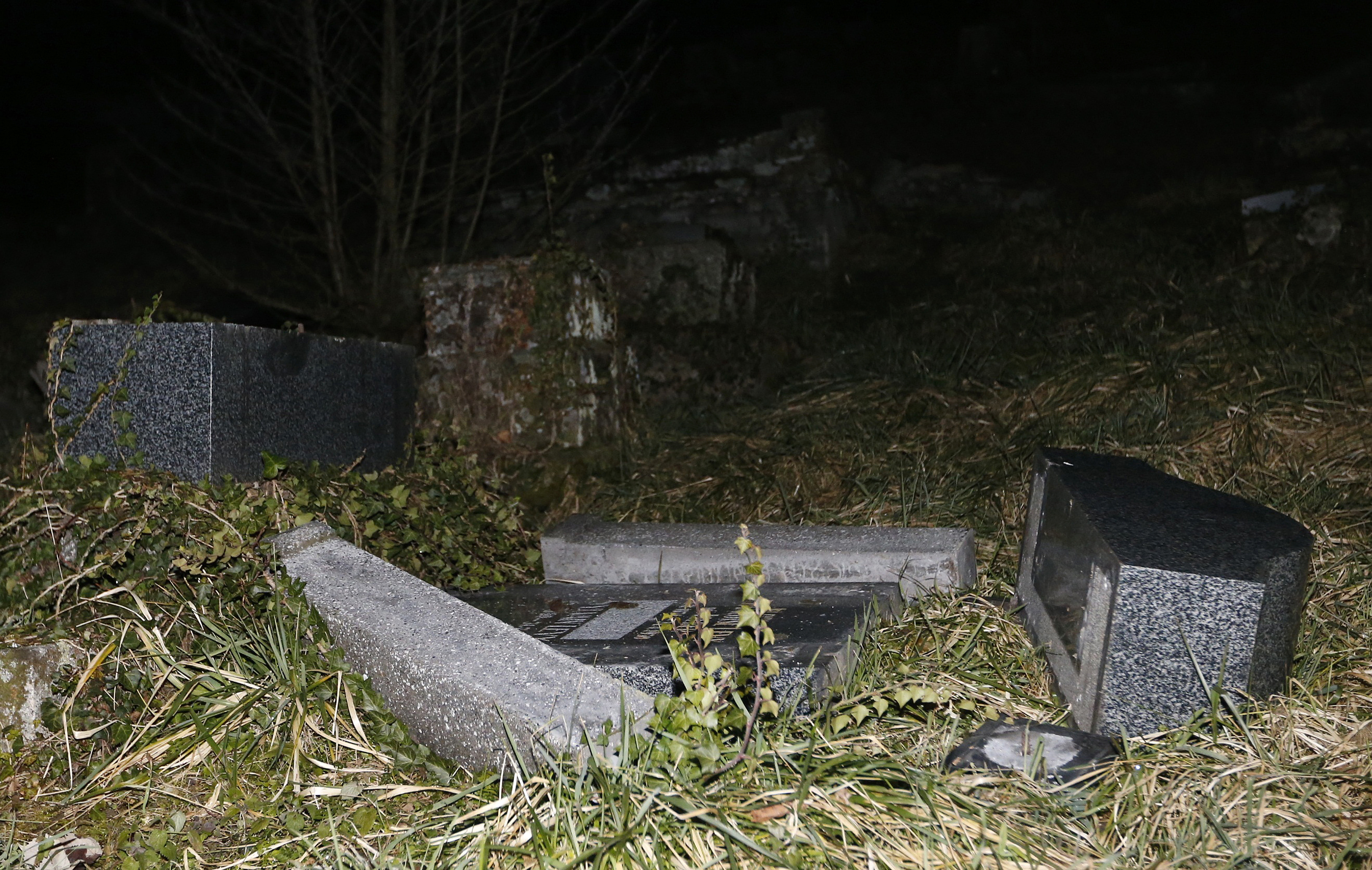 Desecrated tombstones are seen at Sarre-Union Jewish cemetery in eastern France on Feb. 15, 2015