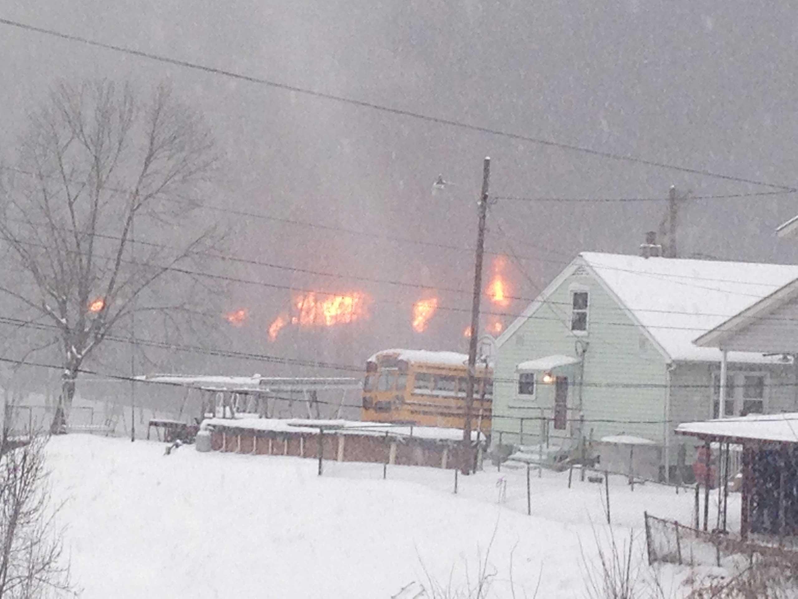A fire burns Monday, Feb. 16, 2015, after a train derailment near Charleston, W.Va.