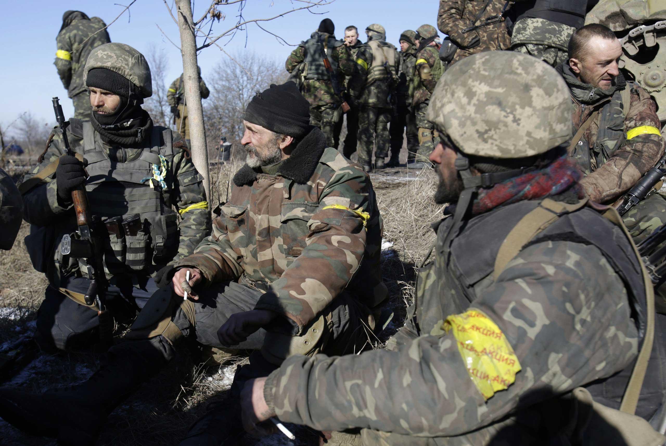 Ukrainian soldiers rest near Artemivsk after leaving Debaltseve in the Donetsk region on Feb. 18, 2015.