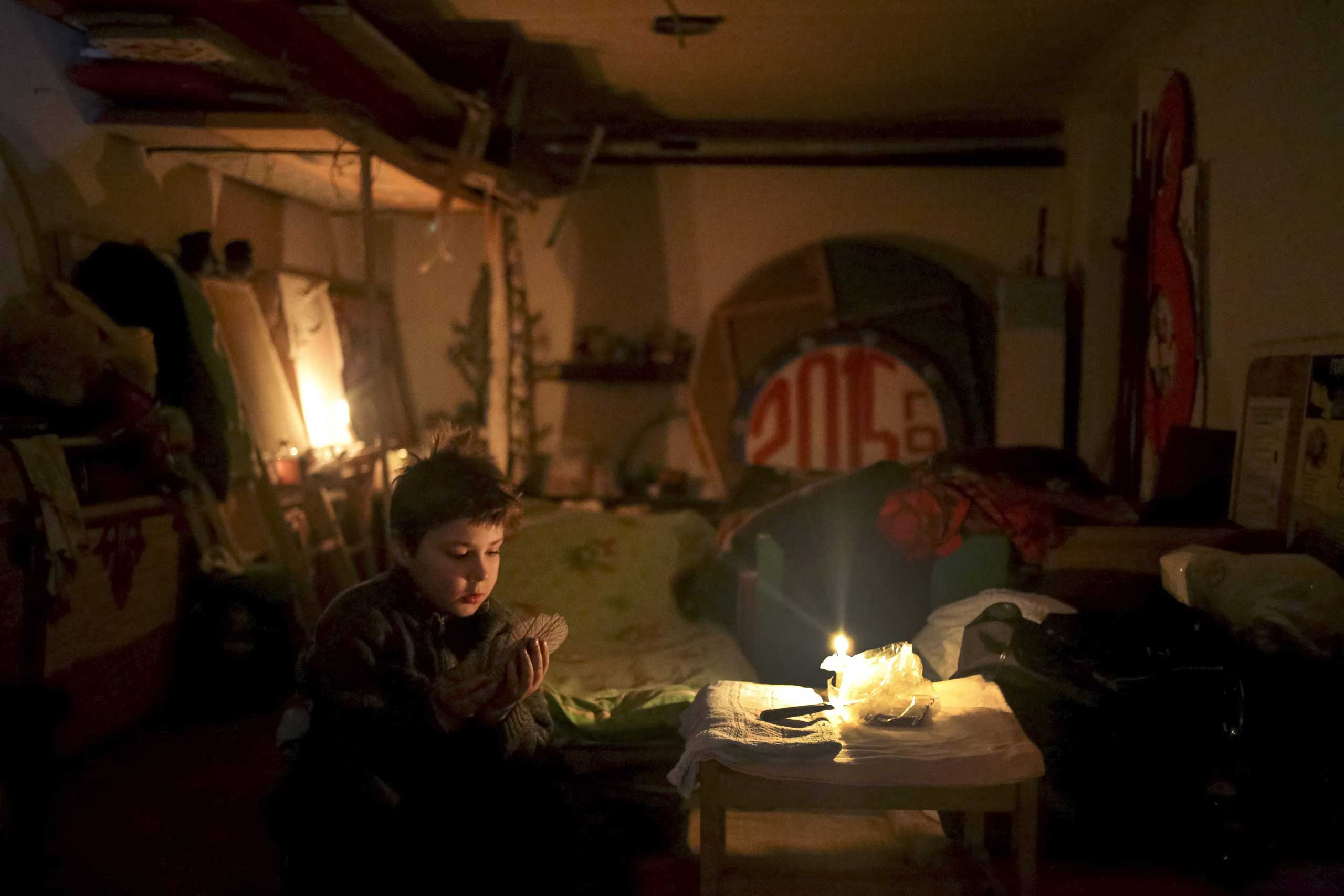 A child plays cards in the local House of Culture which is used as a bomb shelter in Mironovka village, Feb. 17,  2015.