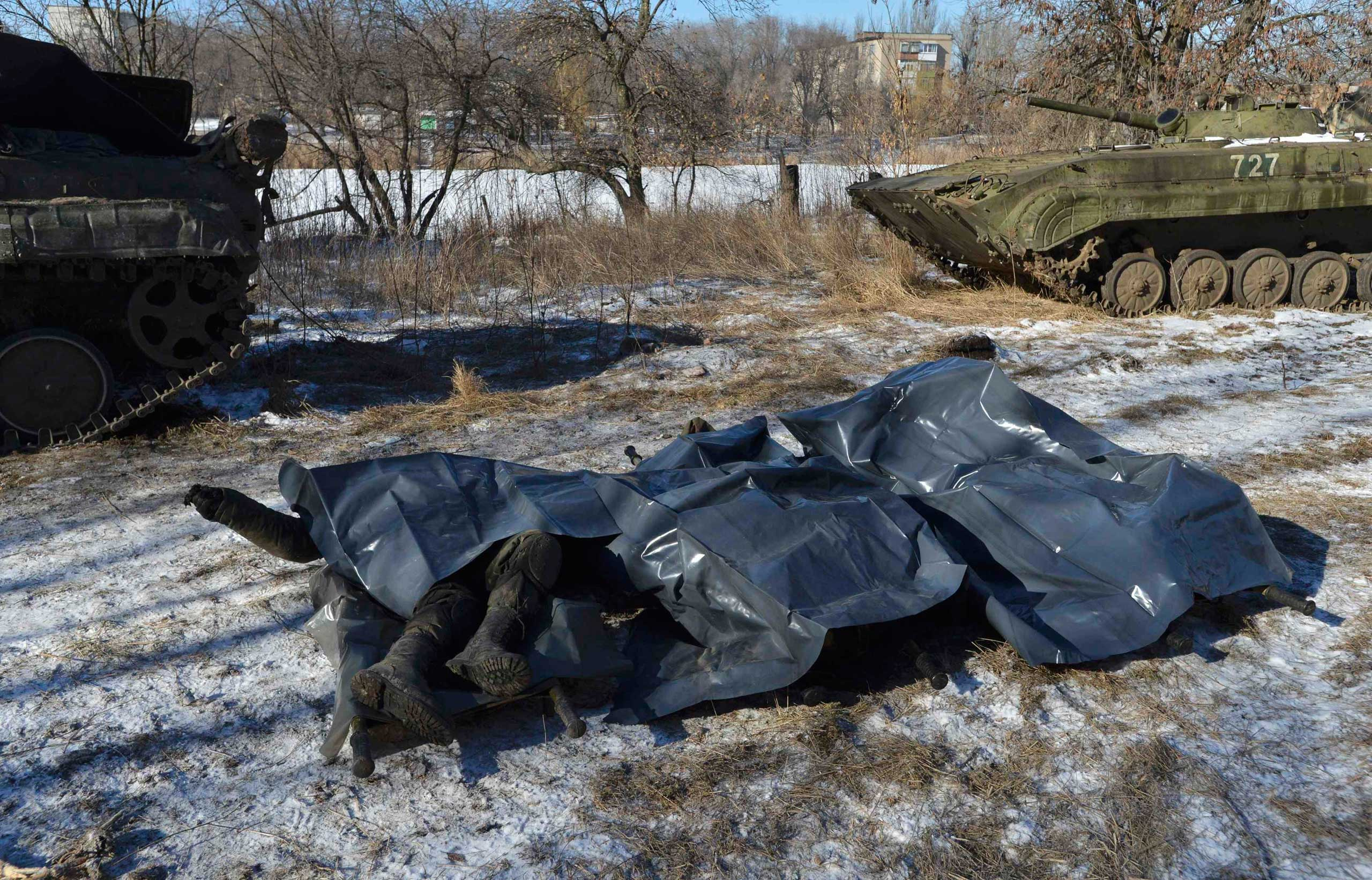 Bodies of Ukrainian soldiers killed in Debaltseve are pictured on stretchers at a military camp in Artemivsk, Feb. 18, 2015.
