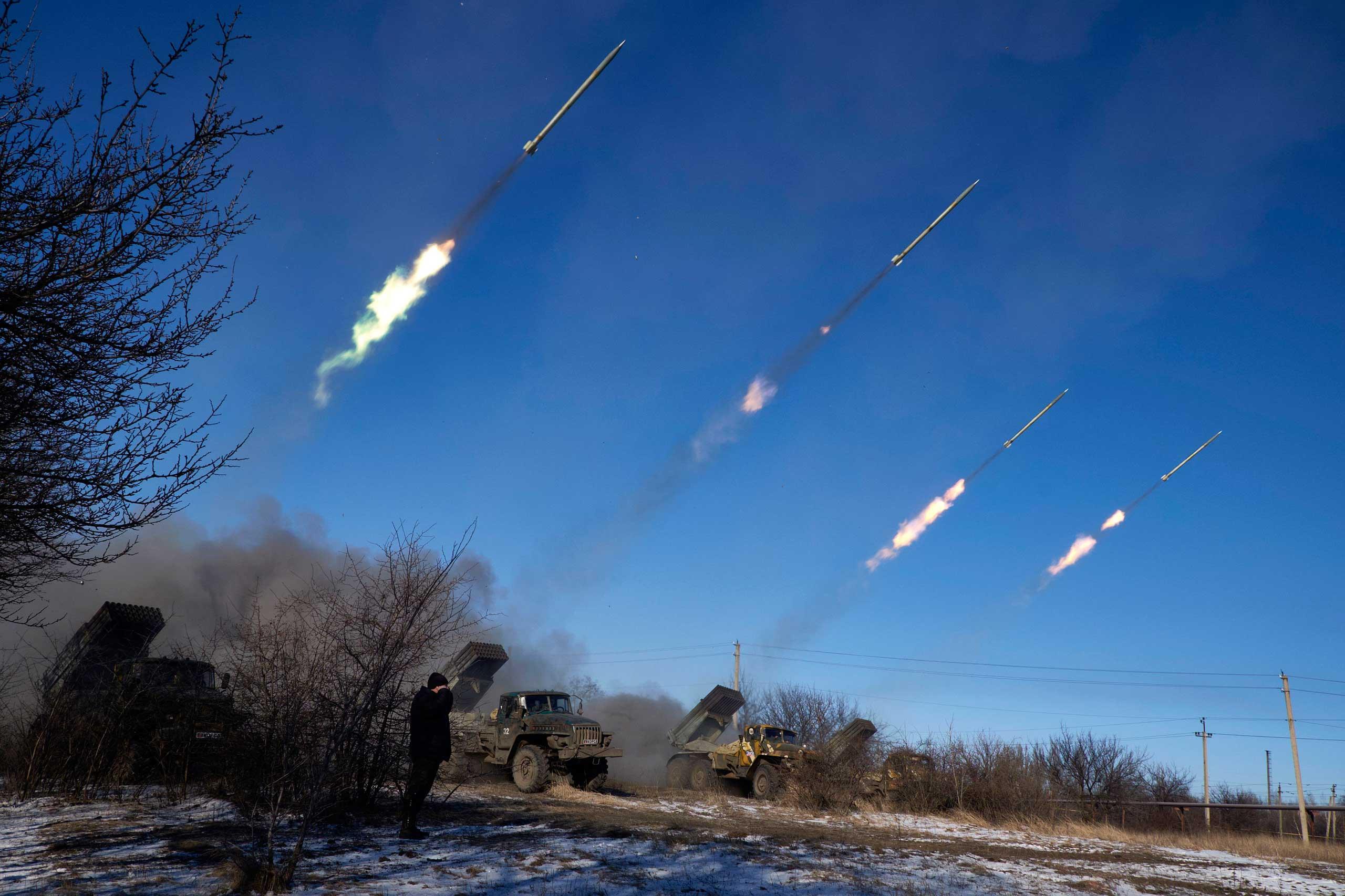 Pro-Russian rebels fire artillery grad rockets towards Debaltseve on Feb. 18, 2015, near Vuglegirsk.