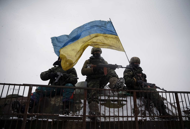 Ukrainian soldiers  ride on a military vehicle near Debaltseve in eastern Ukraine on Feb. 16, 2015.