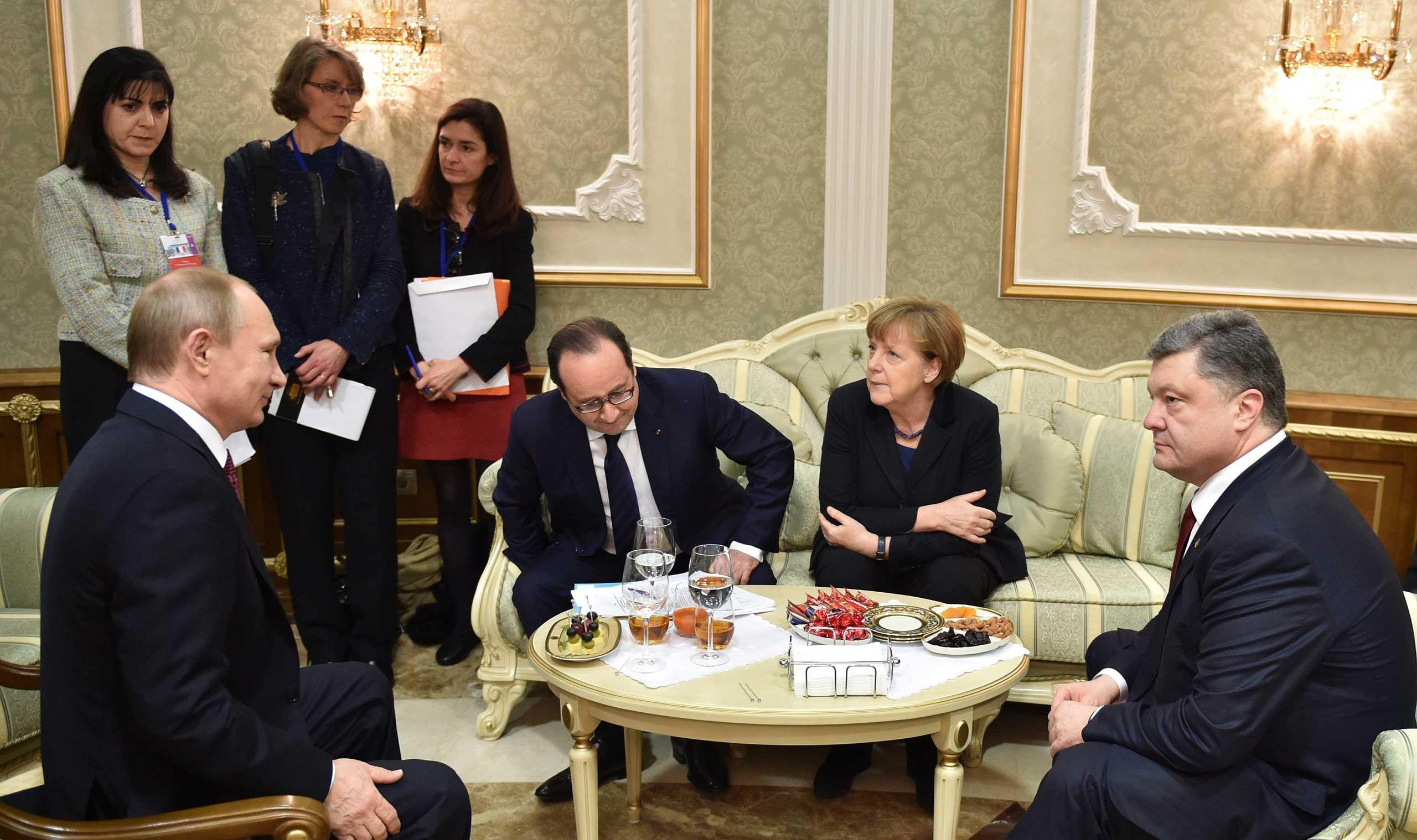 Russia's President Vladimir Putin, France's President Francois Hollande, Germany's Chancellor Angela Merkel and Ukraine's President Petro Poroshenko attend a meeting on resolving the Ukrainian crisis in Minsk, Belarus, Feb. 11, 2015.