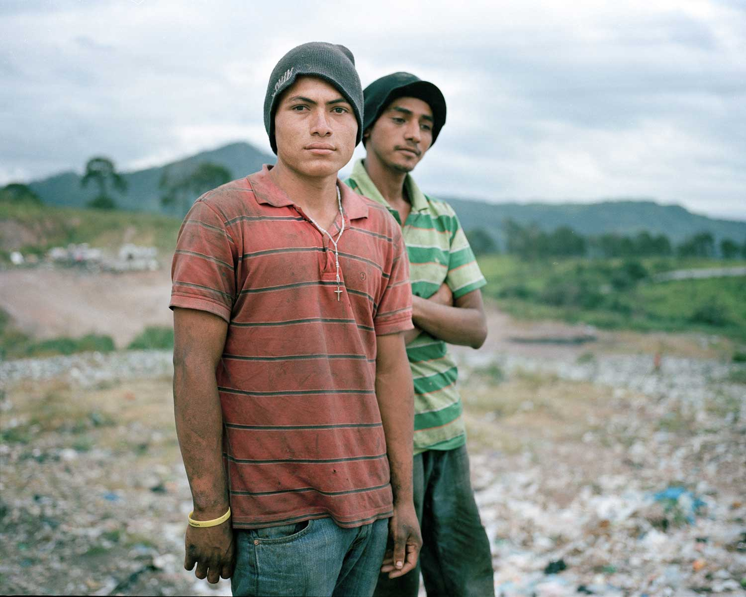Angel and Gerson pose for a portrait in the municipal dump where they work in Tegucigalpa. This image forms part of Dominic Bracco II's Visionary Award project.