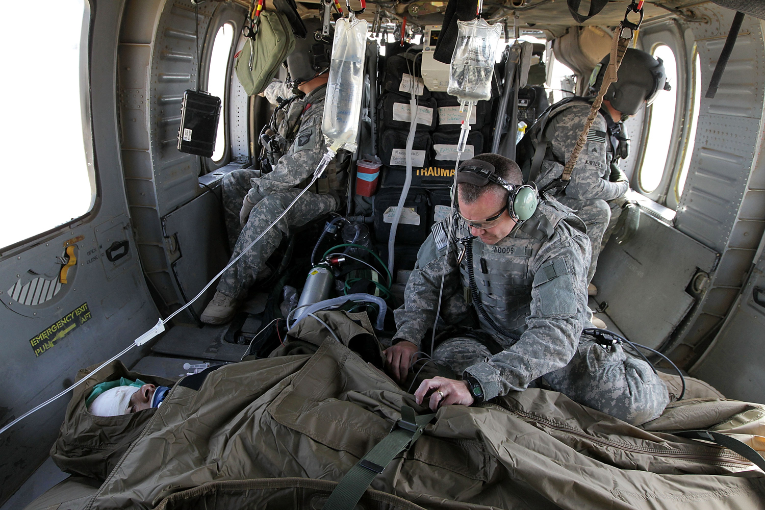 A U.S. Army doctor monitors a patient inside a MEDEVAC helicopter on June 20, 2010, in Kandahar, Afghanistan.