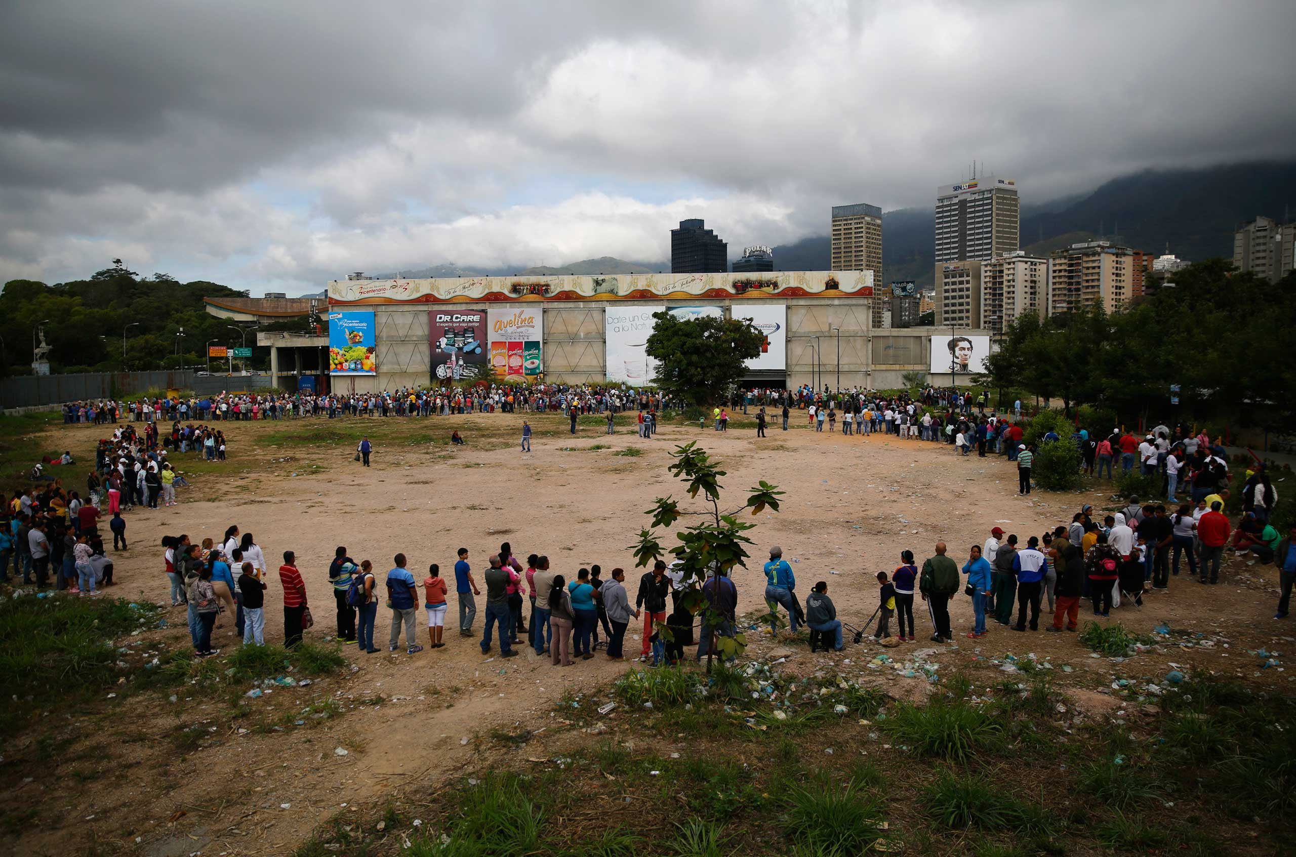 People line up outside a state-run Bicentenario supermarket in Caracas,  Jan. 9, 2015.