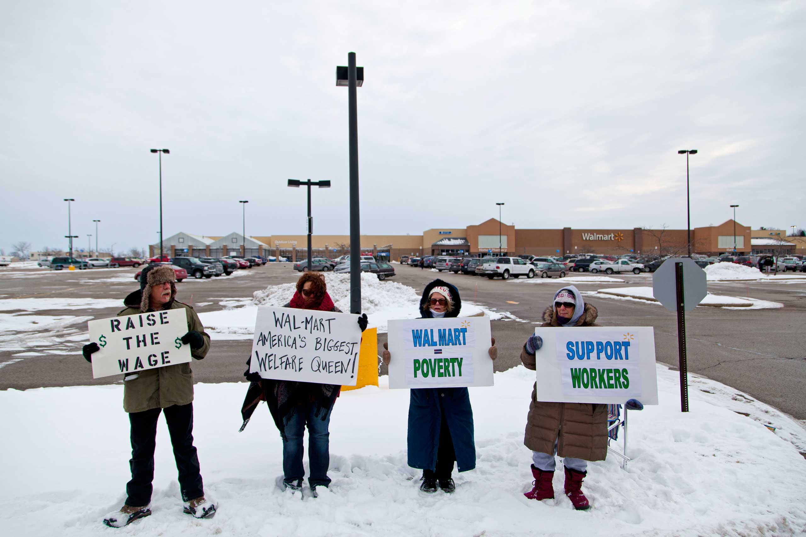Protestors outside of the Watertown Walmart  on Black Friday, Nov. 28, 2014 in Watertown, Wis.