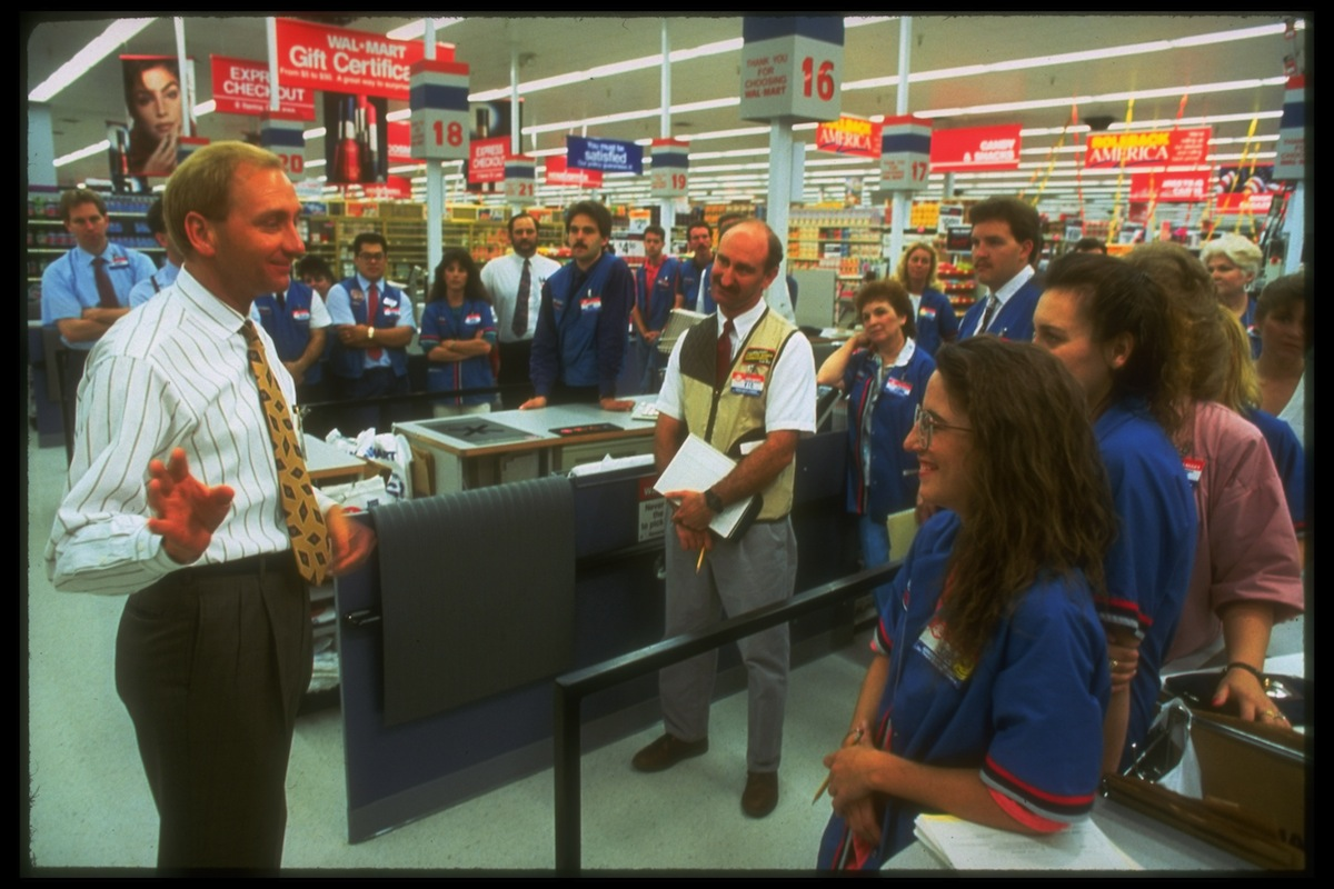 Wal-Mart regional VP Andy Wilson (L) giving a pep talk on corporate values at a Wal-Mart store, in 1992