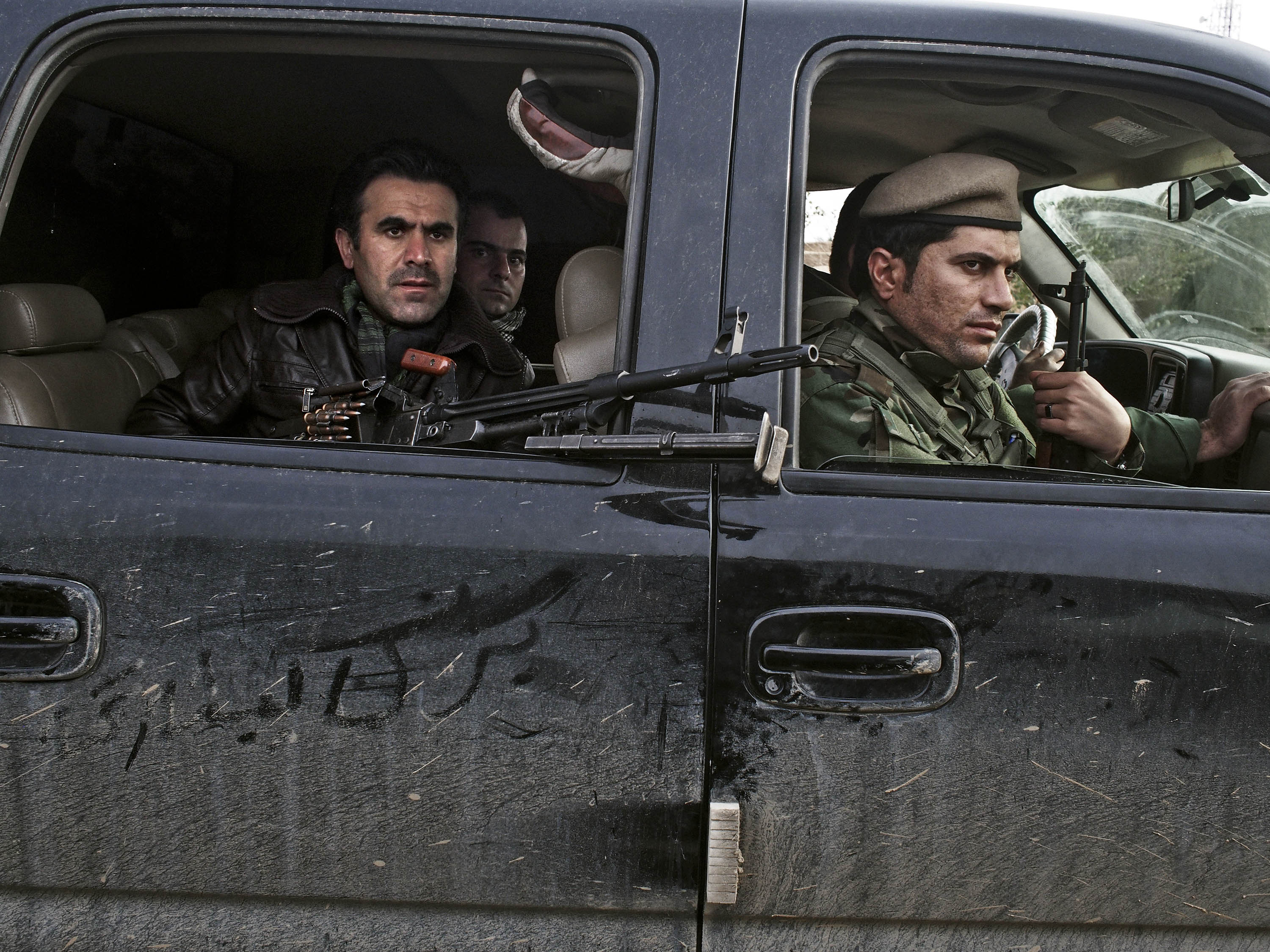 Counterattack: Kurdish soldiers drive through an Iraqi village in December after taking it back from ISIS forces