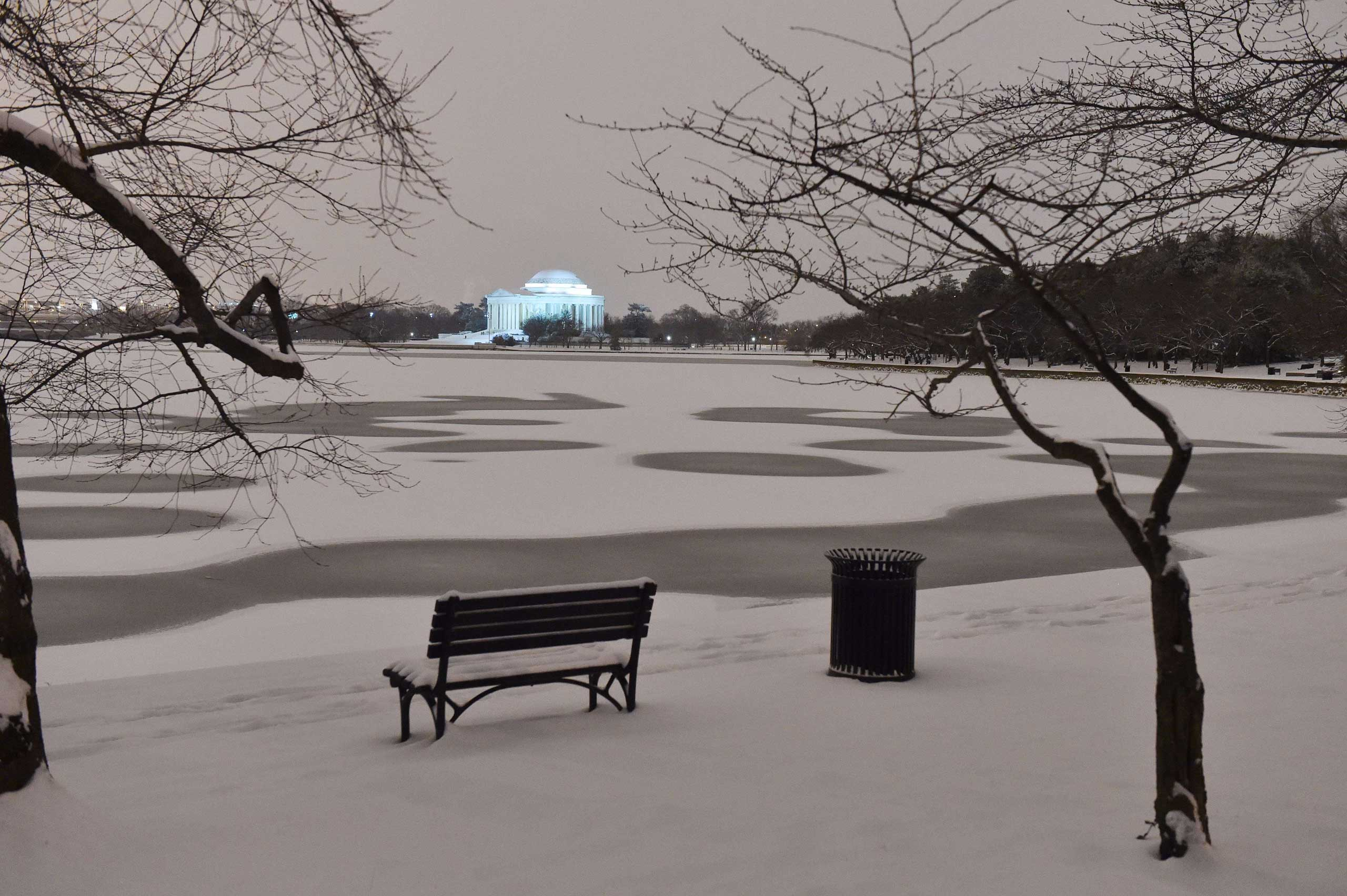 Snow covers the Tidal Basin in front of Jefferson Memorial in Washington on Feb. 16, 2015.
